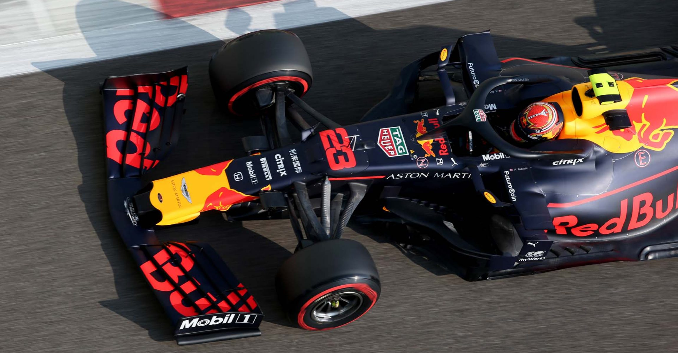 ABU DHABI, UNITED ARAB EMIRATES - NOVEMBER 30: Alexander Albon of Thailand driving the (23) Aston Martin Red Bull Racing RB15 on track during final practice for the F1 Grand Prix of Abu Dhabi at Yas Marina Circuit on November 30, 2019 in Abu Dhabi, United Arab Emirates. (Photo by Charles Coates/Getty Images) // Getty Images / Red Bull Content Pool // AP-22BGP9W5N1W11 // Usage for editorial use only //