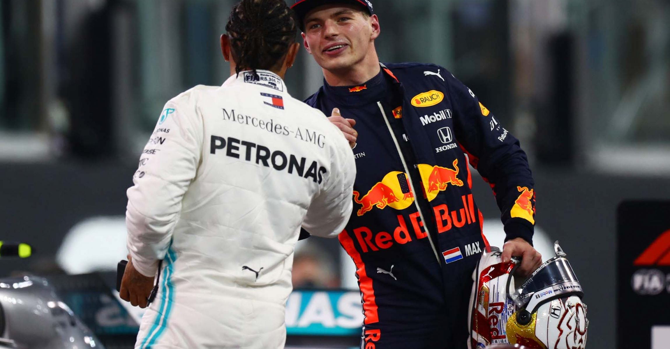 ABU DHABI, UNITED ARAB EMIRATES - NOVEMBER 30: Pole position qualifier Lewis Hamilton of Great Britain and Mercedes GP is congratulated by third placed qualifier Max Verstappen of Netherlands and Red Bull Racing in parc ferme during qualifying for the F1 Grand Prix of Abu Dhabi at Yas Marina Circuit on November 30, 2019 in Abu Dhabi, United Arab Emirates. (Photo by Dan Istitene/Getty Images) // Getty Images / Red Bull Content Pool // AP-22BHGCD9S1W11 // Usage for editorial use only //