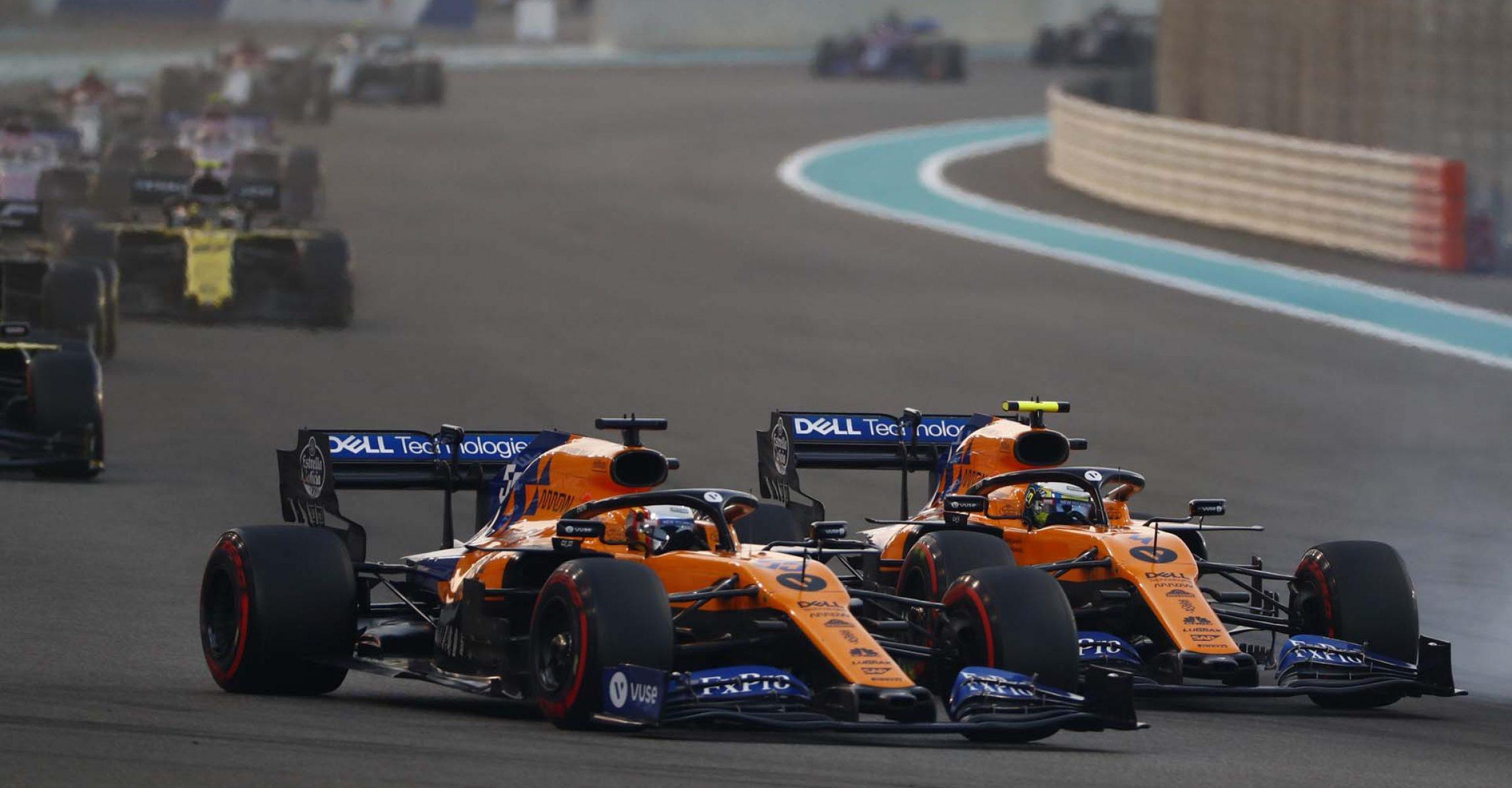 Carlos Sainz, McLaren MCL34 battles with Lando Norris, McLaren MCL34