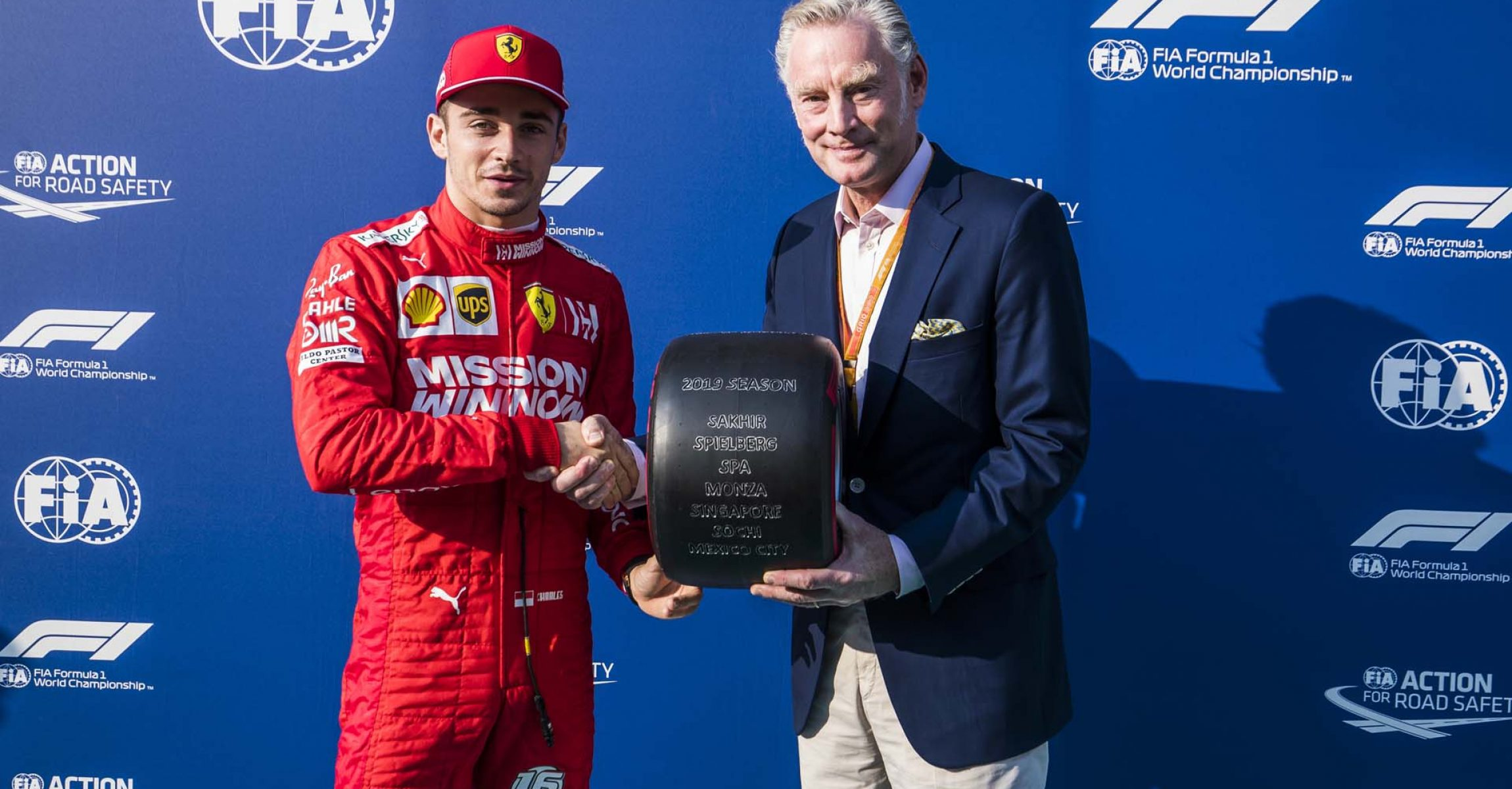 YAS MARINA CIRCUIT, UNITED ARAB EMIRATES - DECEMBER 01: Charles Leclerc, Ferrari, receives the Pirelli Pole Position of 2019 Award from Sean Bratches, Managing Director of Commercial Operations, Formula One Group during the Abu Dhabi GP at Yas Marina Circuit on December 01, 2019 in Yas Marina Circuit, United Arab Emirates. (Photo by Sam Bloxham / LAT Images)