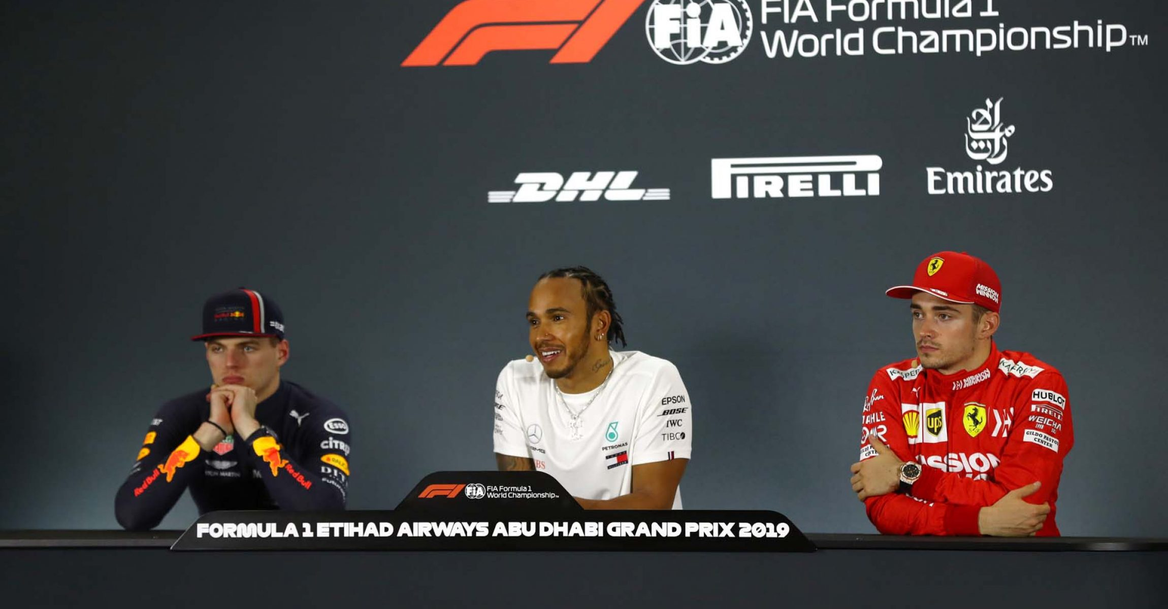 ABU DHABI, UNITED ARAB EMIRATES - DECEMBER 01: Race winner Lewis Hamilton of Great Britain and Mercedes GP, second placed Max Verstappen of Netherlands and Red Bull Racing and third placed Charles Leclerc of Monaco and Ferrari talk in the press conference after the F1 Grand Prix of Abu Dhabi at Yas Marina Circuit on December 01, 2019 in Abu Dhabi, United Arab Emirates. (Photo by Francois Nel/Getty Images) // Getty Images / Red Bull Content Pool // AP-22BVJNRX92111 // Usage for editorial use only //