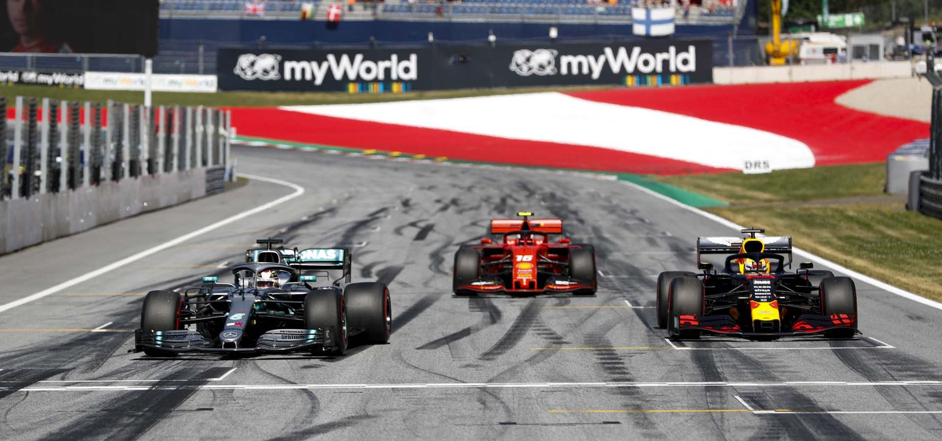 RED BULL RING, AUSTRIA - JUNE 29: Lewis Hamilton, Mercedes AMG F1 W10, Pole Sitter Charles Leclerc, Ferrari SF90 and Max Verstappen, Red Bull Racing RB15 driving into Parc Ferme during the Austrian GP at Red Bull Ring on June 29, 2019 in Red Bull Ring, Austria. (Photo by Steven Tee / LAT Images)