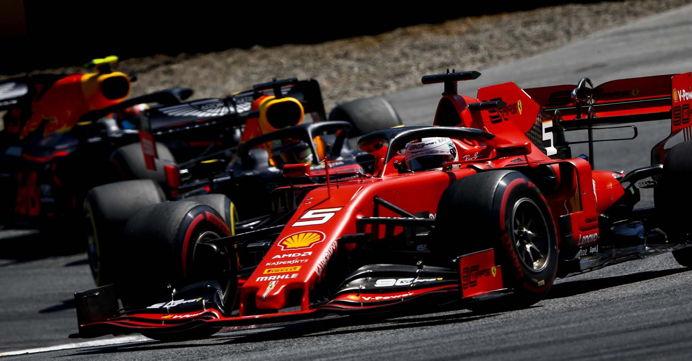 RED BULL RING, AUSTRIA - JUNE 30: Sebastian Vettel, Ferrari SF90, leads Pierre Gasly, Red Bull Racing RB15 during the Austrian GP at Red Bull Ring on June 30, 2019 in Red Bull Ring, Austria. (Photo by Andy Hone / LAT Images)