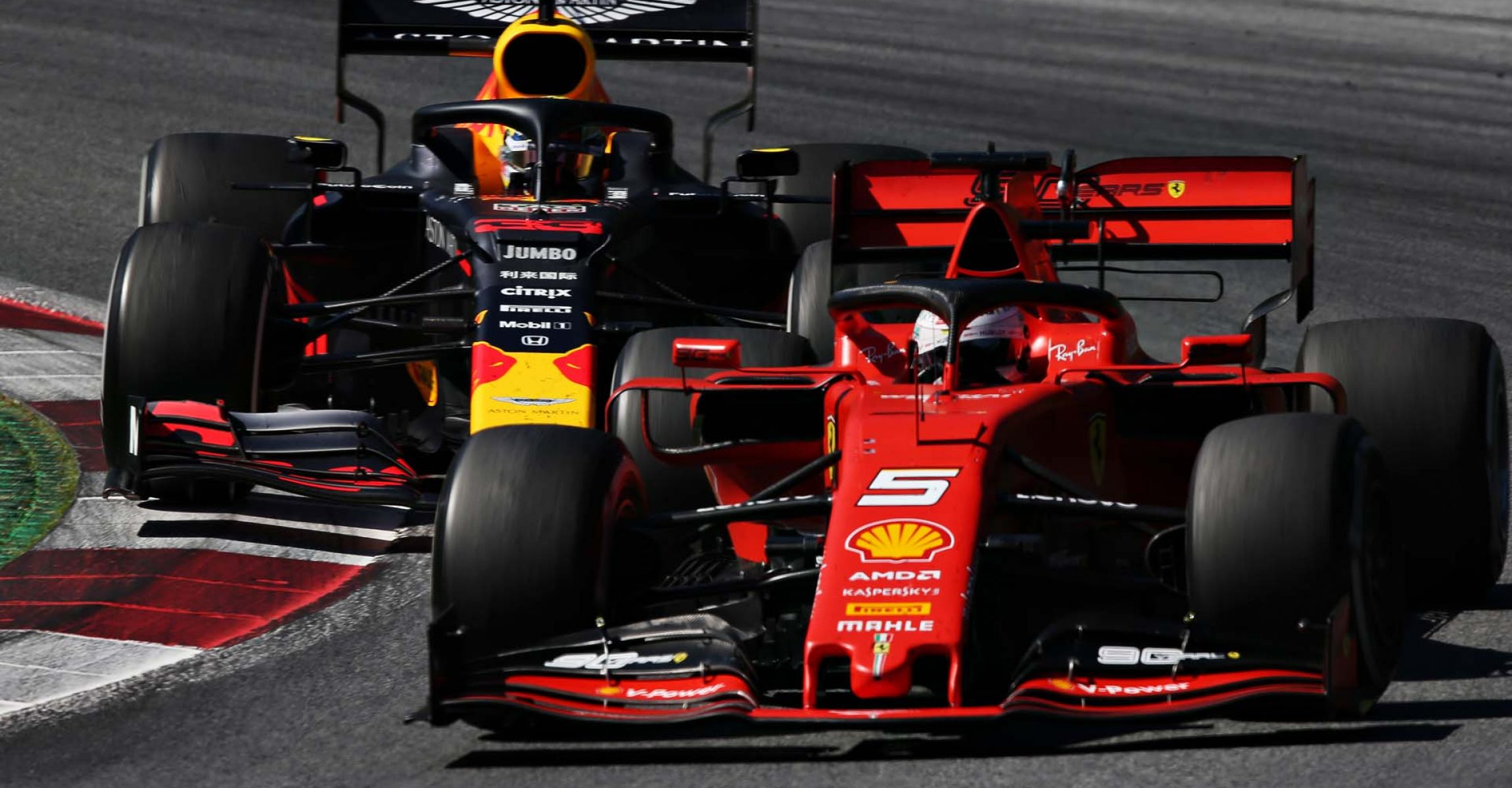 SPIELBERG, AUSTRIA - JUNE 30: Sebastian Vettel of Germany driving the (5) Scuderia Ferrari SF90 leads Max Verstappen of the Netherlands driving the (33) Aston Martin Red Bull Racing RB15 on track during the F1 Grand Prix of Austria at Red Bull Ring on June 30, 2019 in Spielberg, Austria. (Photo by Charles Coates/Getty Images) // Getty Images / Red Bull Content Pool  // AP-1ZT9G2UNH2111 // Usage for editorial use only // Please go to www.redbullcontentpool.com for further information. //