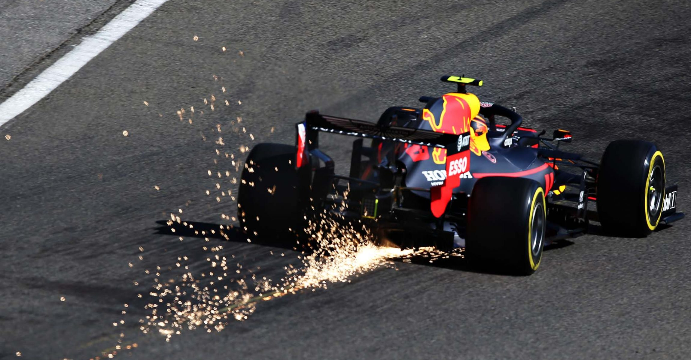 SPA, BELGIUM - AUGUST 30: Sparks fly behind Alexander Albon of Thailand driving the (23) Aston Martin Red Bull Racing RB15 on track during practice for the F1 Grand Prix of Belgium at Circuit de Spa-Francorchamps on August 30, 2019 in Spa, Belgium. (Photo by Charles Coates/Getty Images) // Getty Images / Red Bull Content Pool  // AP-21DWD4T5S2111 // Usage for editorial use only //