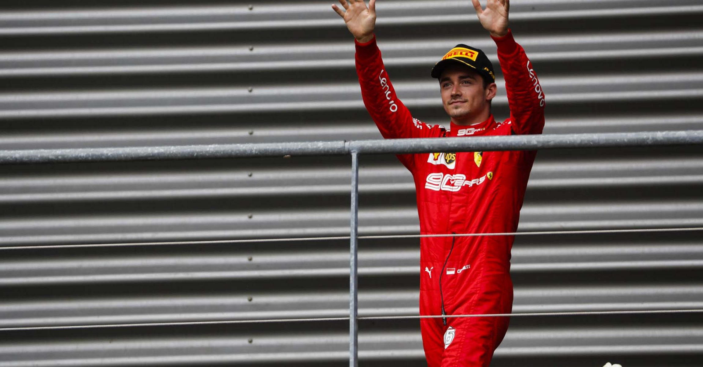 SPA-FRANCORCHAMPS, BELGIUM - SEPTEMBER 01: Charles Leclerc, Ferrari, celebrates victory on the podium during the Belgian GP at Spa-Francorchamps on September 01, 2019 in Spa-Francorchamps, Belgium. (Photo by Sam Bloxham / LAT Images)