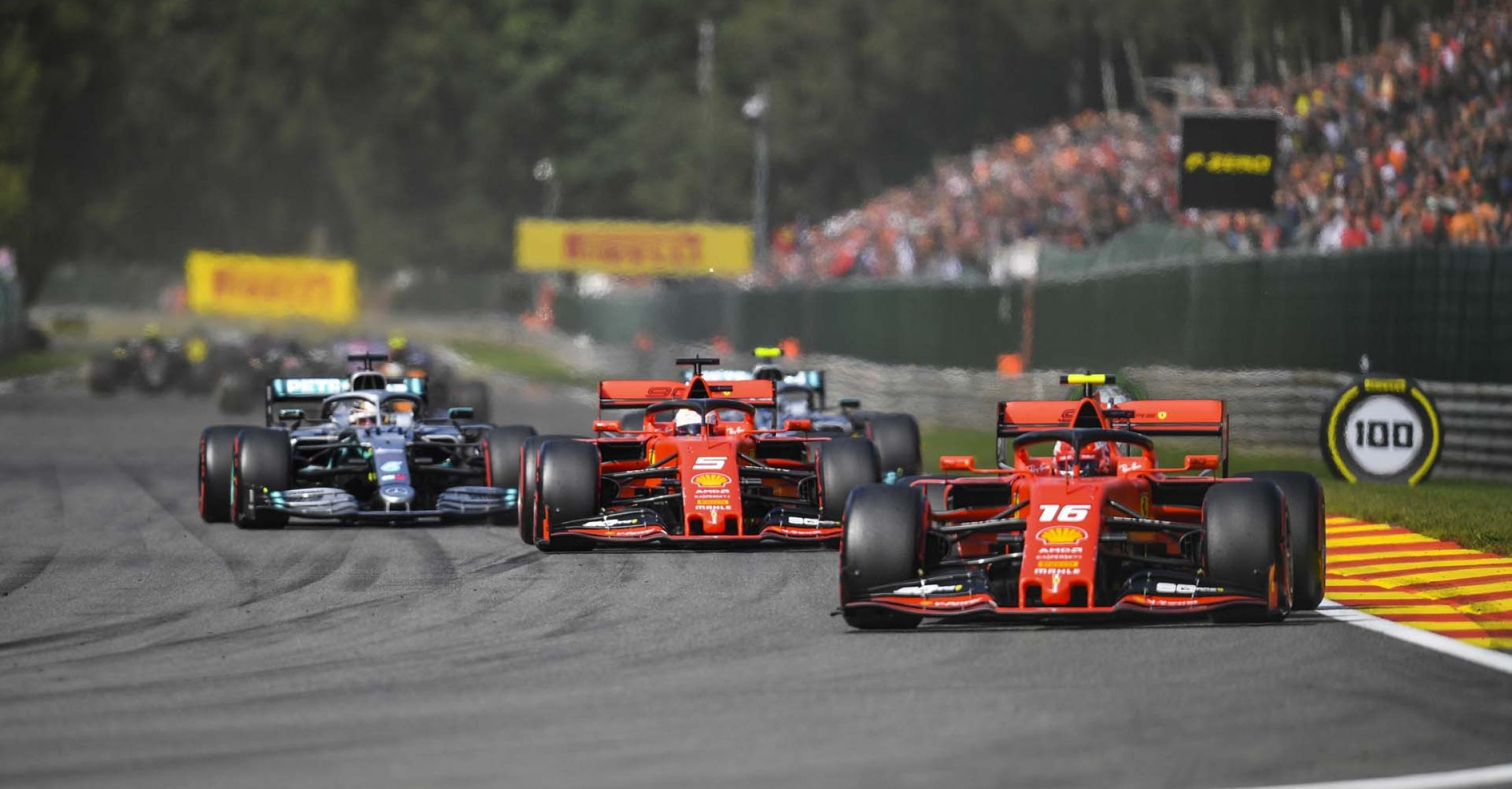 SPA-FRANCORCHAMPS, BELGIUM - SEPTEMBER 01: Charles Leclerc, Ferrari SF90, leads Sebastian Vettel, Ferrari SF90, Lewis Hamilton, Mercedes AMG F1 W10, Valtteri Bottas, Mercedes AMG W10, and the rest of the field on the opening lap during the Belgian GP at Spa-Francorchamps on September 01, 2019 in Spa-Francorchamps, Belgium. (Photo by Simon Galloway / LAT Images)
