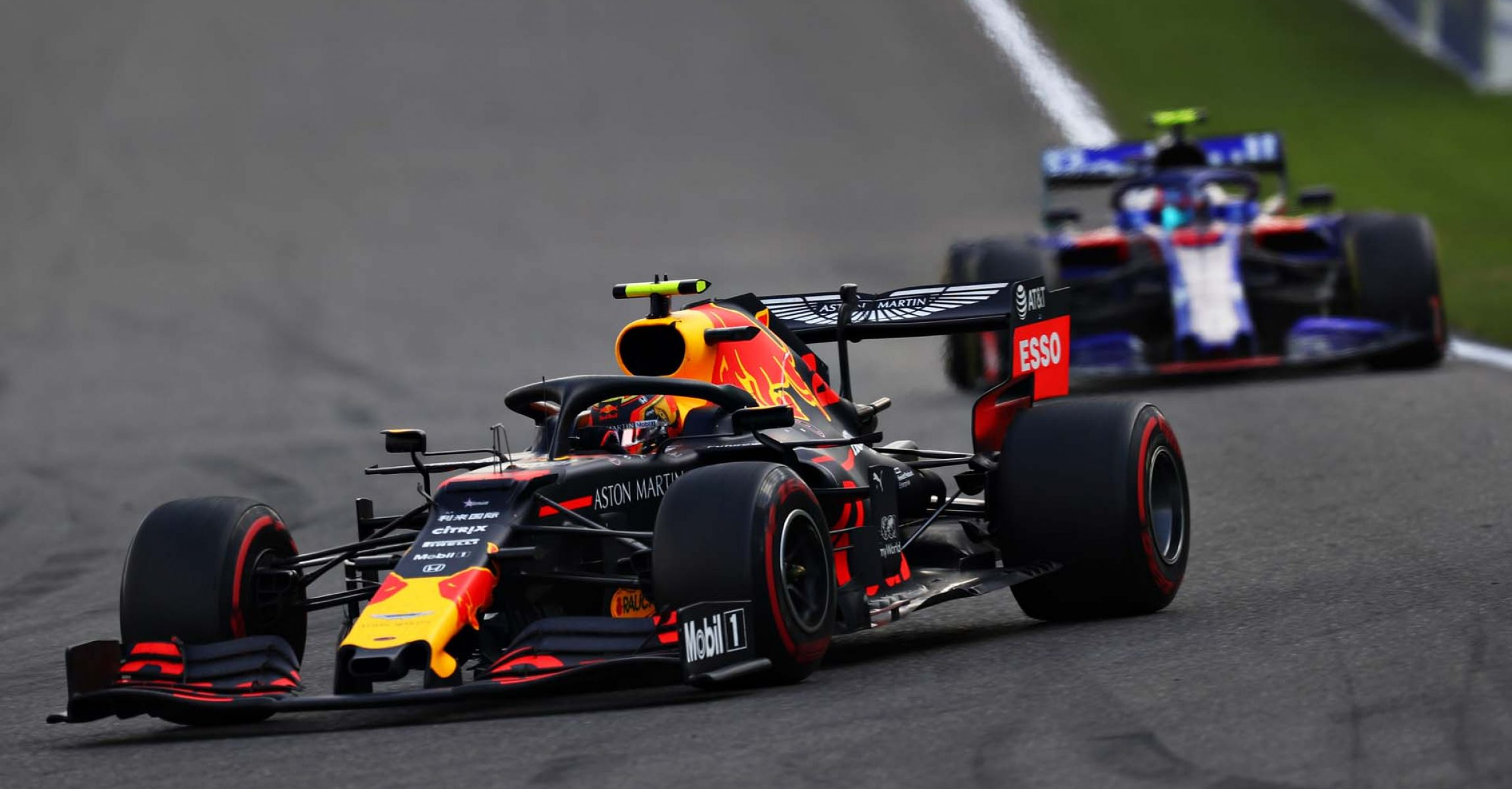 SPA, BELGIUM - SEPTEMBER 01: Alexander Albon of Thailand driving the (23) Aston Martin Red Bull Racing RB15 leads Pierre Gasly of France driving the (10) Scuderia Toro Rosso STR14 Honda on track during the F1 Grand Prix of Belgium at Circuit de Spa-Francorchamps on September 01, 2019 in Spa, Belgium. (Photo by Mark Thompson/Getty Images) // Getty Images / Red Bull Content Pool // AP-21EJBRGRH2111 // Usage for editorial use only //
