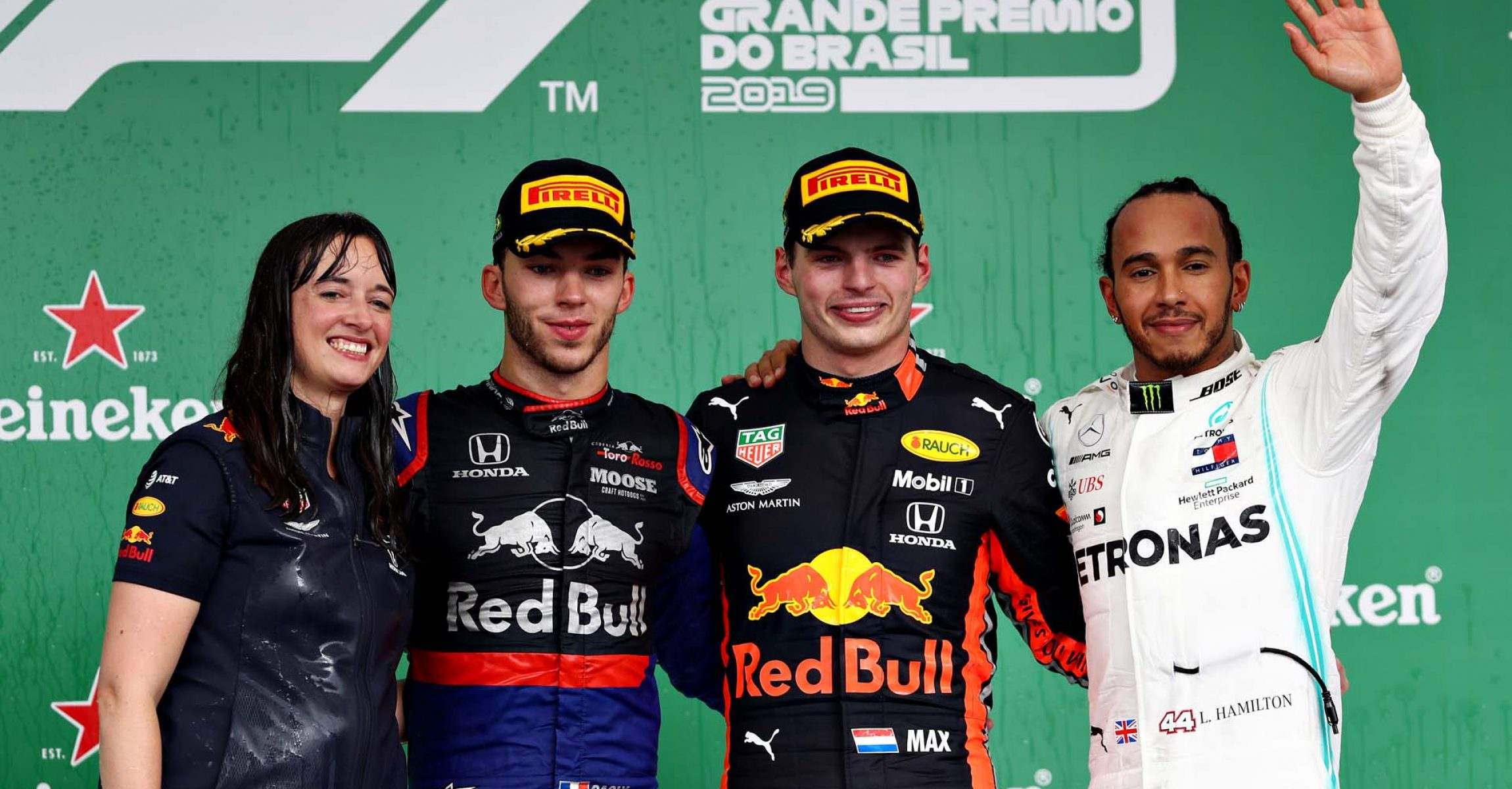 SAO PAULO, BRAZIL - NOVEMBER 17: Top three finishers Max Verstappen of Netherlands and Red Bull Racing, Pierre Gasly of France and Scuderia Toro Rosso and Lewis Hamilton of Great Britain and Mercedes GP celebrate on the podium during the F1 Grand Prix of Brazil at Autodromo Jose Carlos Pace on November 17, 2019 in Sao Paulo, Brazil. (Photo by Mark Thompson/Getty Images) // Getty Images / Red Bull Content Pool // AP-227DWW5451W11 // Usage for editorial use only // Hannah Schmitz