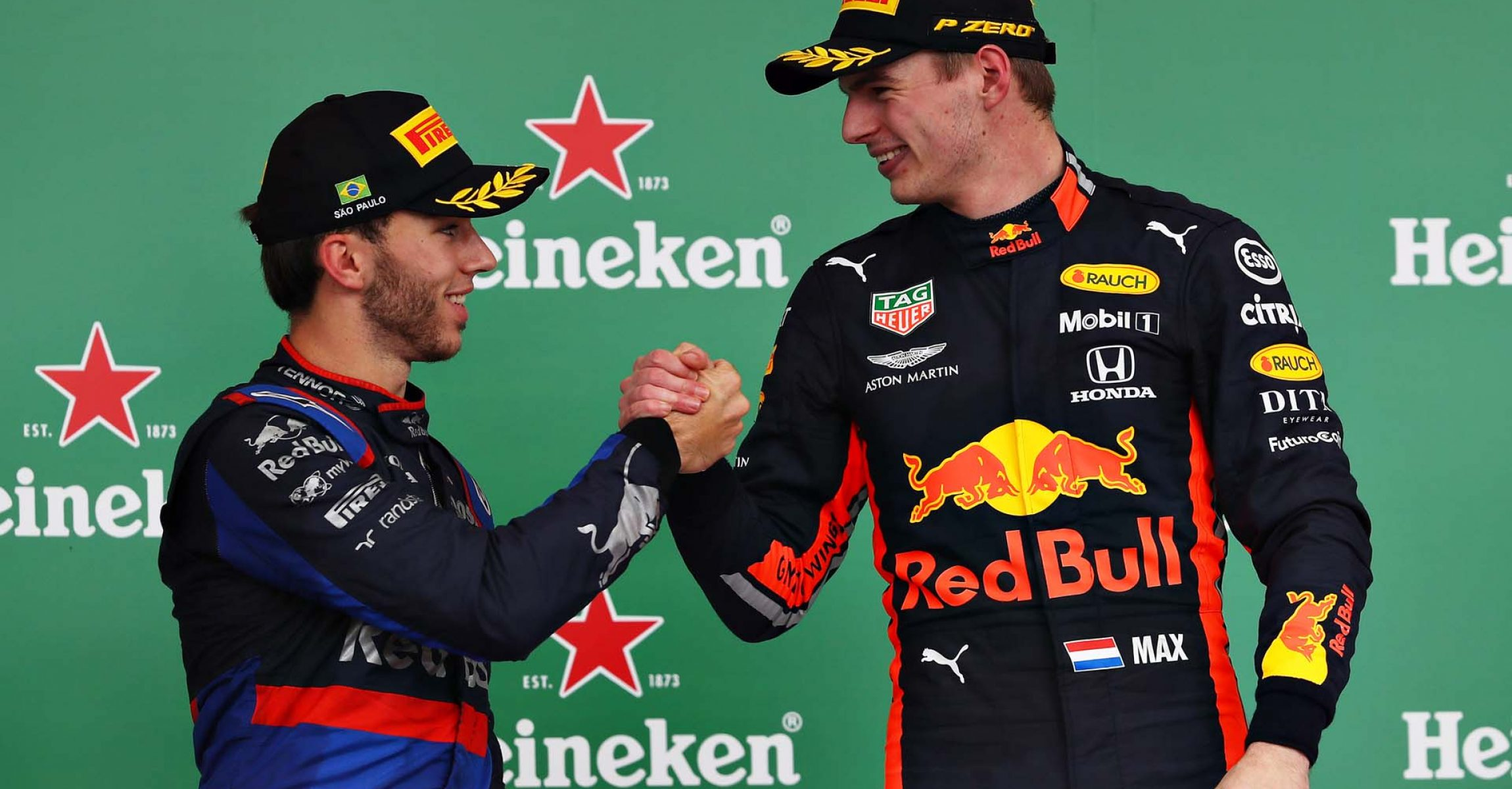 SAO PAULO, BRAZIL - NOVEMBER 17: Race winner Max Verstappen of Netherlands and Red Bull Racing and second placed Pierre Gasly of France and Scuderia Toro Rosso celebrate on the podium during the F1 Grand Prix of Brazil at Autodromo Jose Carlos Pace on November 17, 2019 in Sao Paulo, Brazil. (Photo by Mark Thompson/Getty Images) // Getty Images / Red Bull Content Pool // AP-227E6KM1S2111 // Usage for editorial use only //