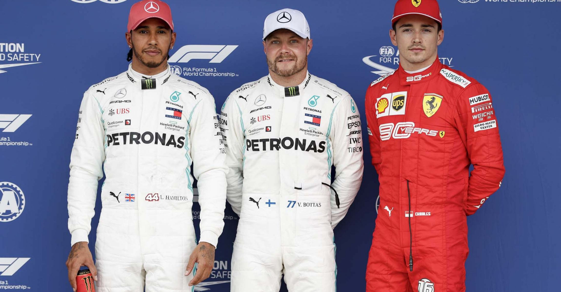 SILVERSTONE, UNITED KINGDOM - JULY 13: Lewis Hamilton, Mercedes AMG F1, Pole Sitter Valtteri Bottas, Mercedes AMG F1 and Charles Leclerc, Ferrari in Parc Ferme during the British GP at Silverstone on July 13, 2019 in Silverstone, United Kingdom. (Photo by Zak Mauger / LAT Images)