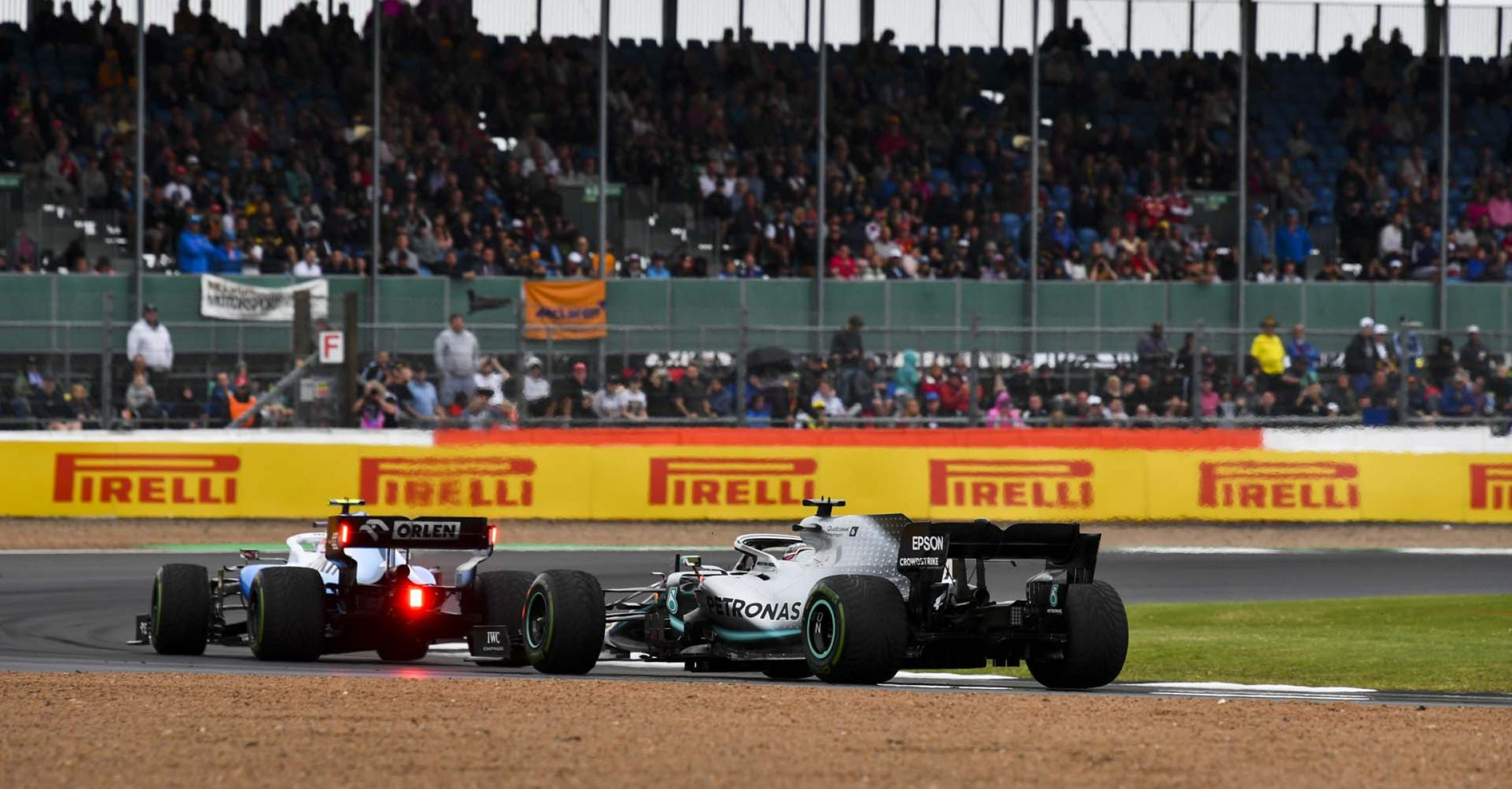 SILVERSTONE, UNITED KINGDOM - JULY 13: Robert Kubica, Williams FW42, leads Lewis Hamilton, Mercedes AMG F1 W10 during the British GP at Silverstone on July 13, 2019 in Silverstone, United Kingdom. (Photo by Mark Sutton / LAT Images)