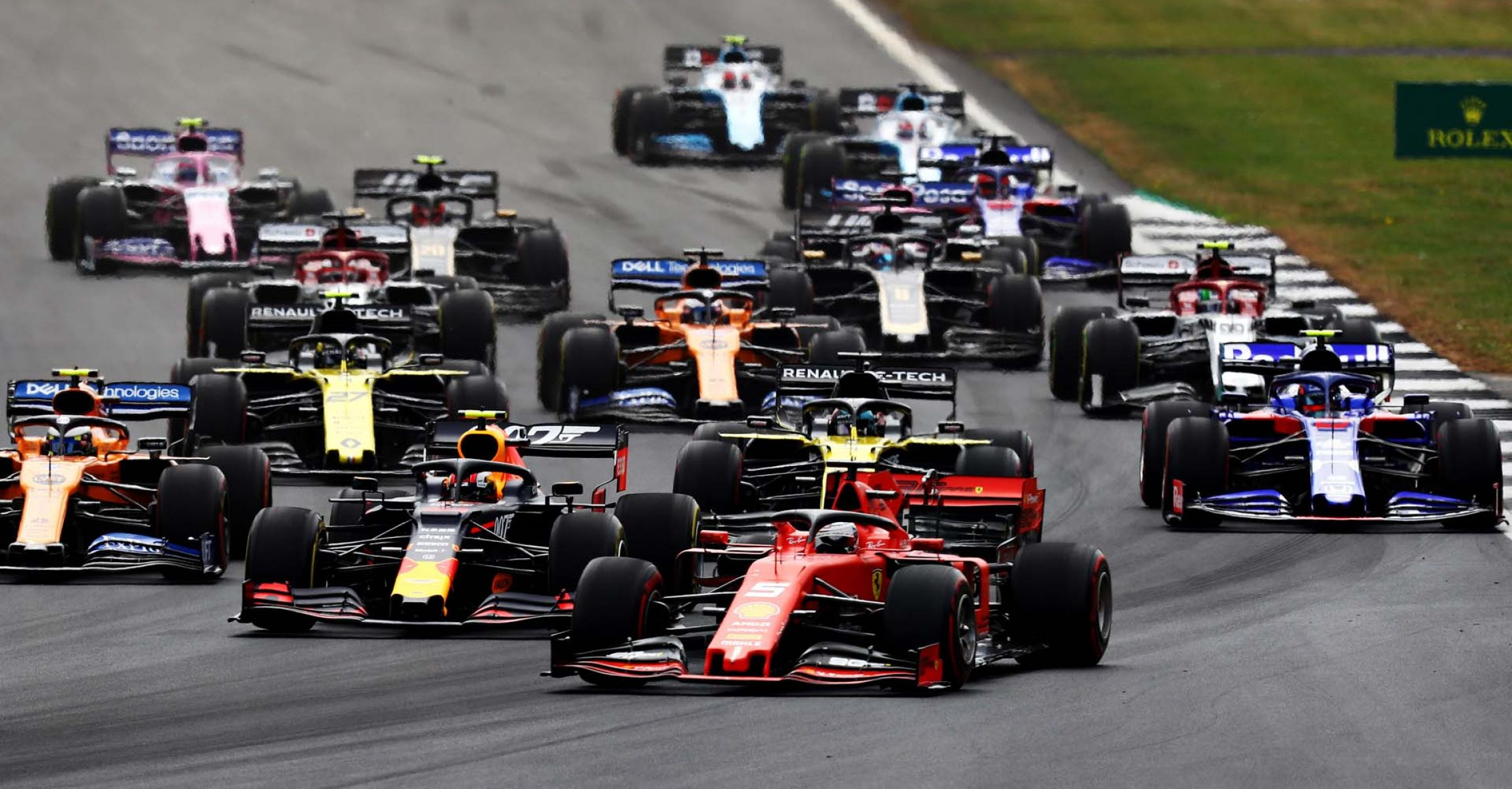 NORTHAMPTON, ENGLAND - JULY 14: Pierre Gasly of France driving the (10) Aston Martin Red Bull Racing RB15 and Sebastian Vettel of Germany driving the (5) Scuderia Ferrari SF90 battle for position at the start during the F1 Grand Prix of Great Britain at Silverstone on July 14, 2019 in Northampton, England. (Photo by Mark Thompson/Getty Images) // Getty Images / Red Bull Content Pool // AP-1ZXSD5NDN2111 // Usage for editorial use only // Please go to www.redbullcontentpool.com for further information. //