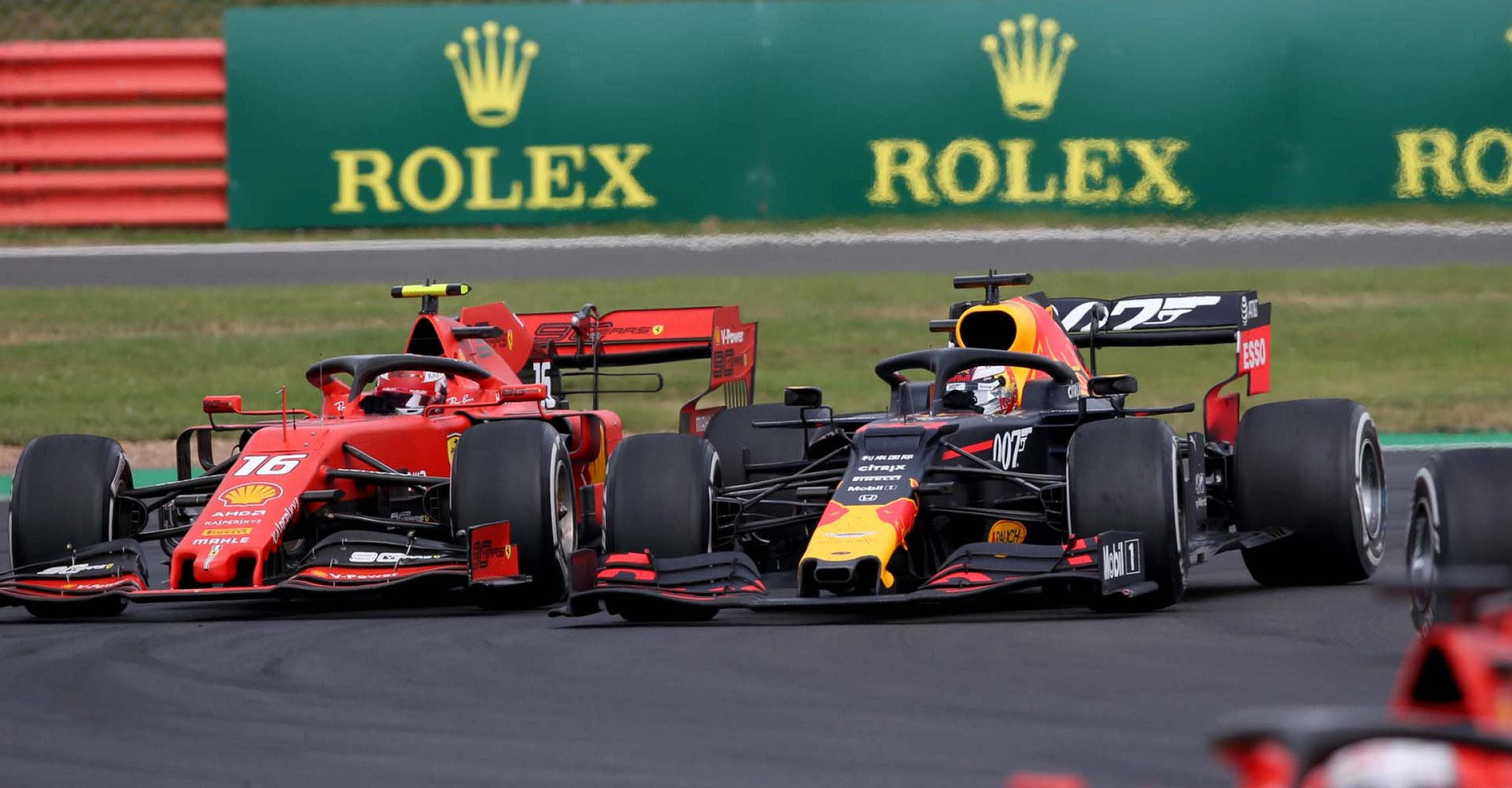 NORTHAMPTON, ENGLAND - JULY 14: Max Verstappen of the Netherlands driving the (33) Aston Martin Red Bull Racing RB15 and Charles Leclerc of Monaco driving the (16) Scuderia Ferrari SF90 battle for track position during the F1 Grand Prix of Great Britain at Silverstone on July 14, 2019 in Northampton, England. (Photo by Charles Coates/Getty Images) // Getty Images / Red Bull Content Pool // AP-1ZXUVTCA92111 // Usage for editorial use only // Please go to www.redbullcontentpool.com for further information. //