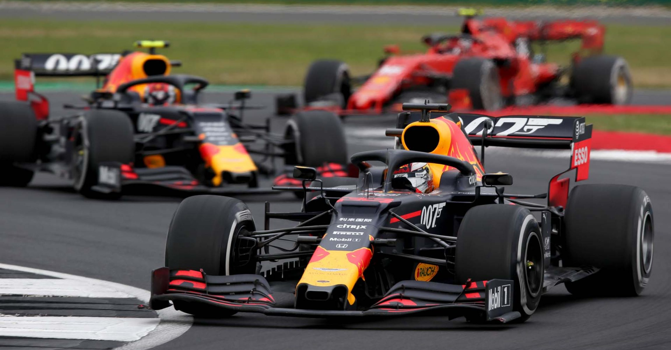 NORTHAMPTON, ENGLAND - JULY 14: Max Verstappen of the Netherlands driving the (33) Aston Martin Red Bull Racing RB15 leads Pierre Gasly of France driving the (10) Aston Martin Red Bull Racing RB15 during the F1 Grand Prix of Great Britain at Silverstone on July 14, 2019 in Northampton, England. (Photo by Charles Coates/Getty Images) // Getty Images / Red Bull Content Pool // AP-1ZXUVU2KN2111 // Usage for editorial use only // Please go to www.redbullcontentpool.com for further information. //