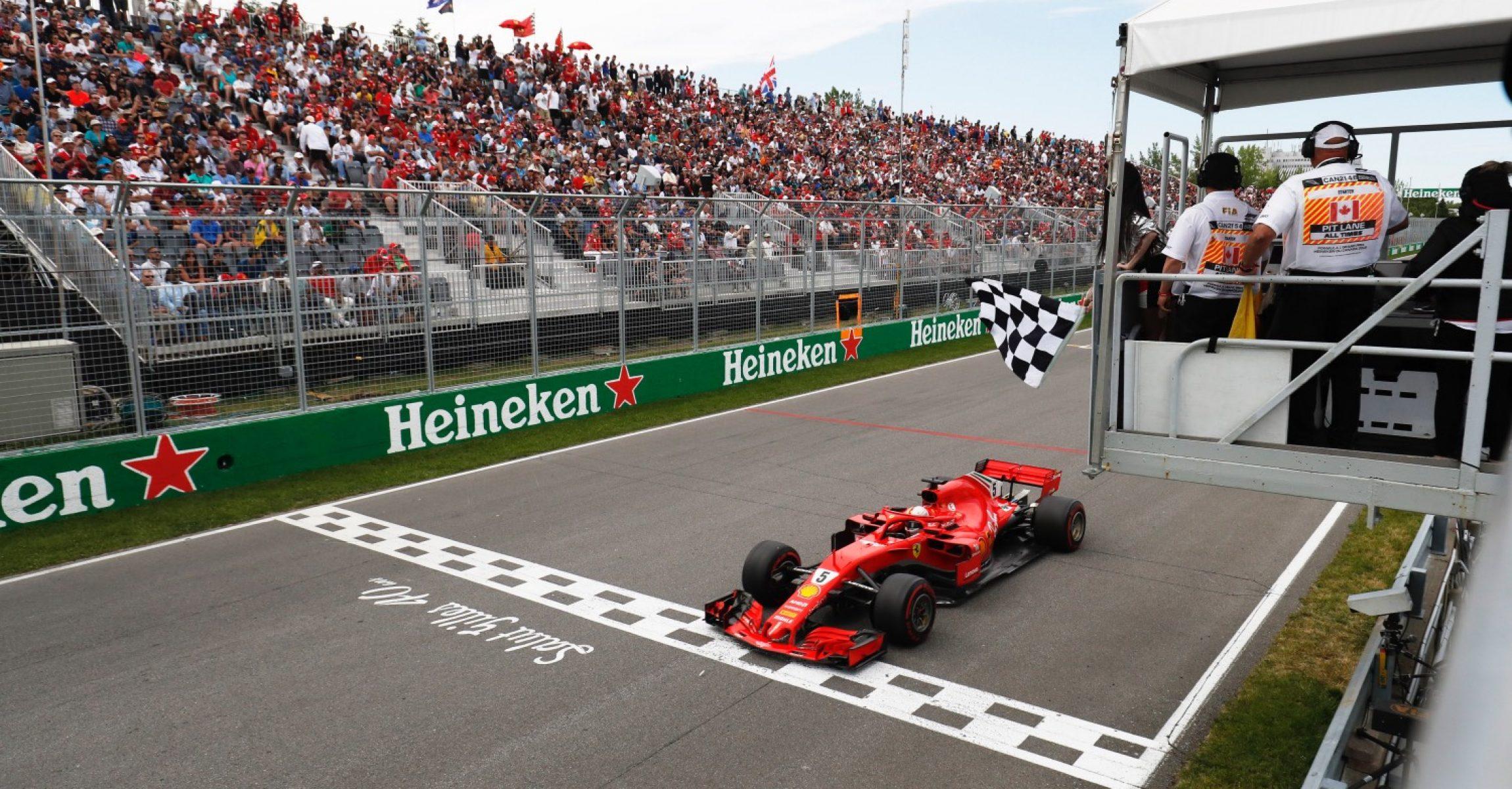 Sebastian Vettel, Ferrari, supermodel Winnie Harlow chequered flag