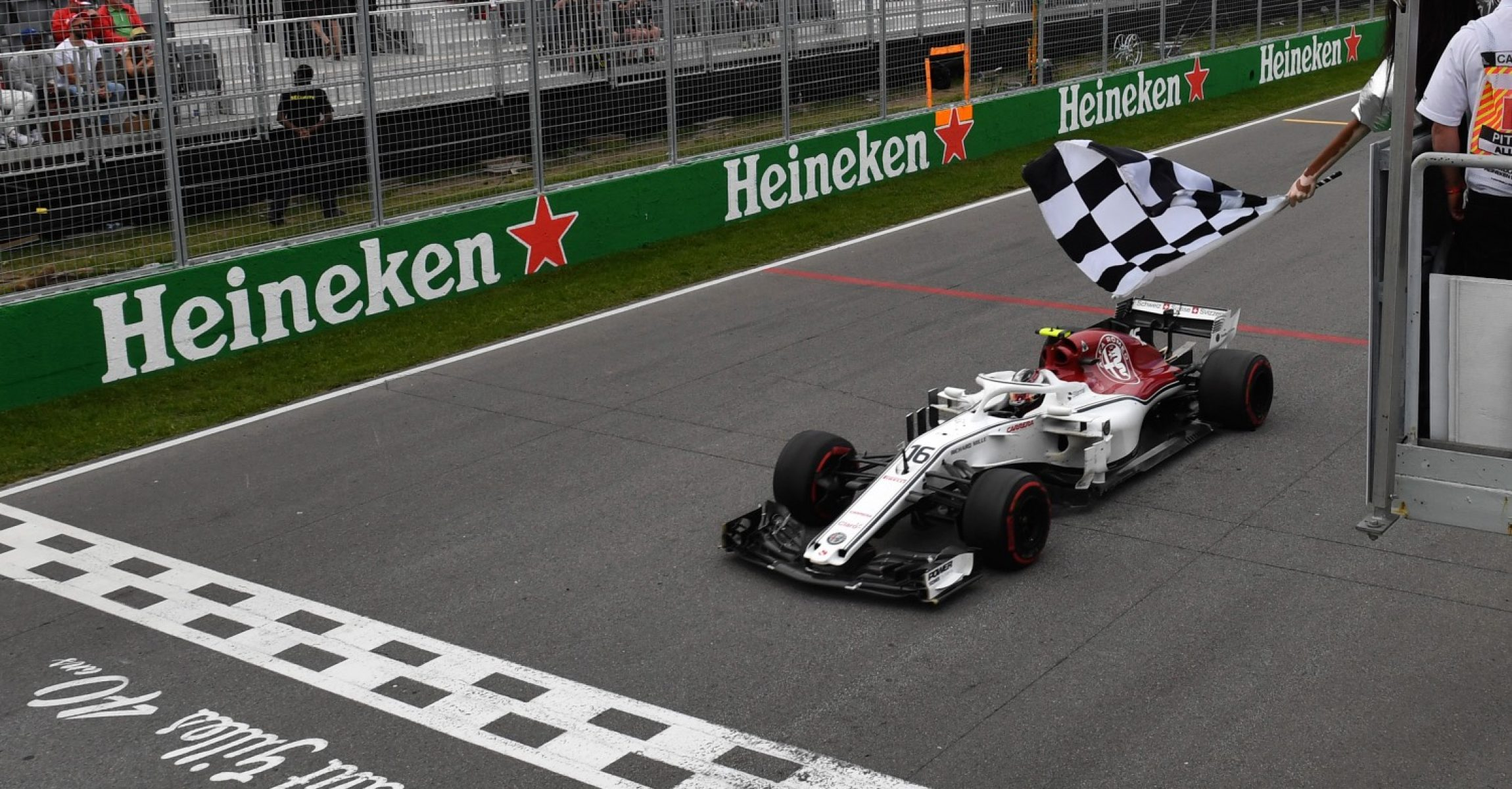Charles Leclerc (MON) Alfa Romeo Sauber C37 takes the chequered flag waved by Winnie Harlow (CDN) at Formula One World Championship, Rd7, Canadian Grand Prix, Race, Montreal, Canada, Sunday10 June 2018.