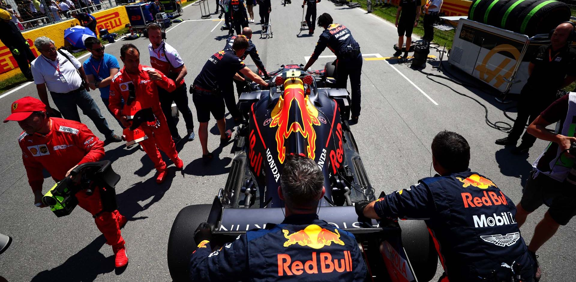 MONTREAL, QC - JUNE 09:  Pierre Gasly of France and Red Bull Racing is pushed to his grid position by members of the team during the F1 Grand Prix of Canada at Circuit Gilles Villeneuve on June 9, 2019 in Montreal, Canada.  (Photo by Dan Istitene/Getty Images) // Getty Images / Red Bull Content Pool  // AP-1ZKN94UF92111 // Usage for editorial use only // Please go to www.redbullcontentpool.com for further information. //