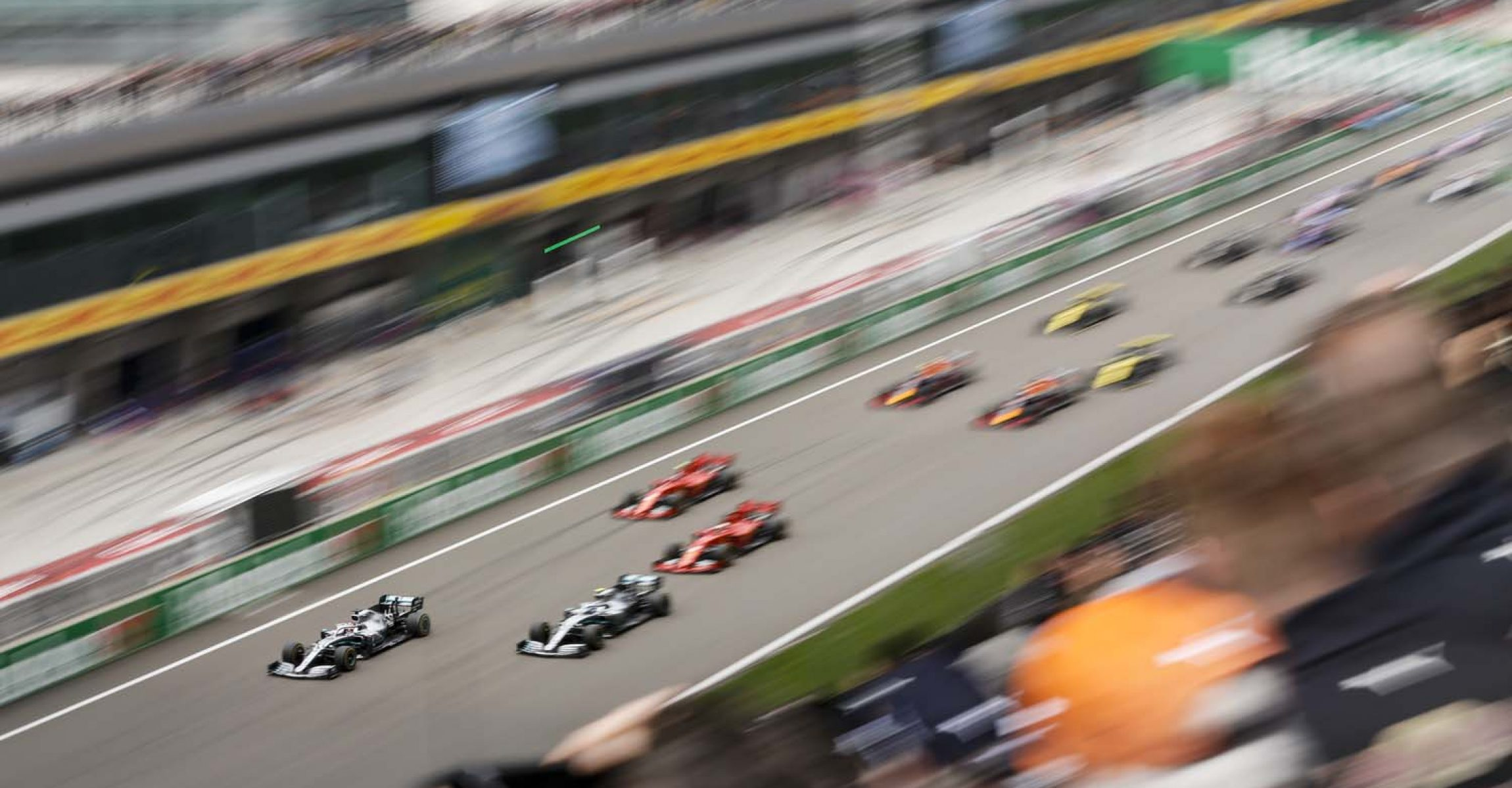 SHANGHAI INTERNATIONAL CIRCUIT, CHINA - APRIL 14: Valtteri Bottas, Mercedes AMG W10, Lewis Hamilton, Mercedes AMG F1 W10, Sebastian Vettel, Ferrari SF90 and Charles Leclerc, Ferrari SF90 at the start of the race during the Chinese GP at Shanghai International Circuit on April 14, 2019 in Shanghai International Circuit, China. (Photo by Zak Mauger / LAT Images)
