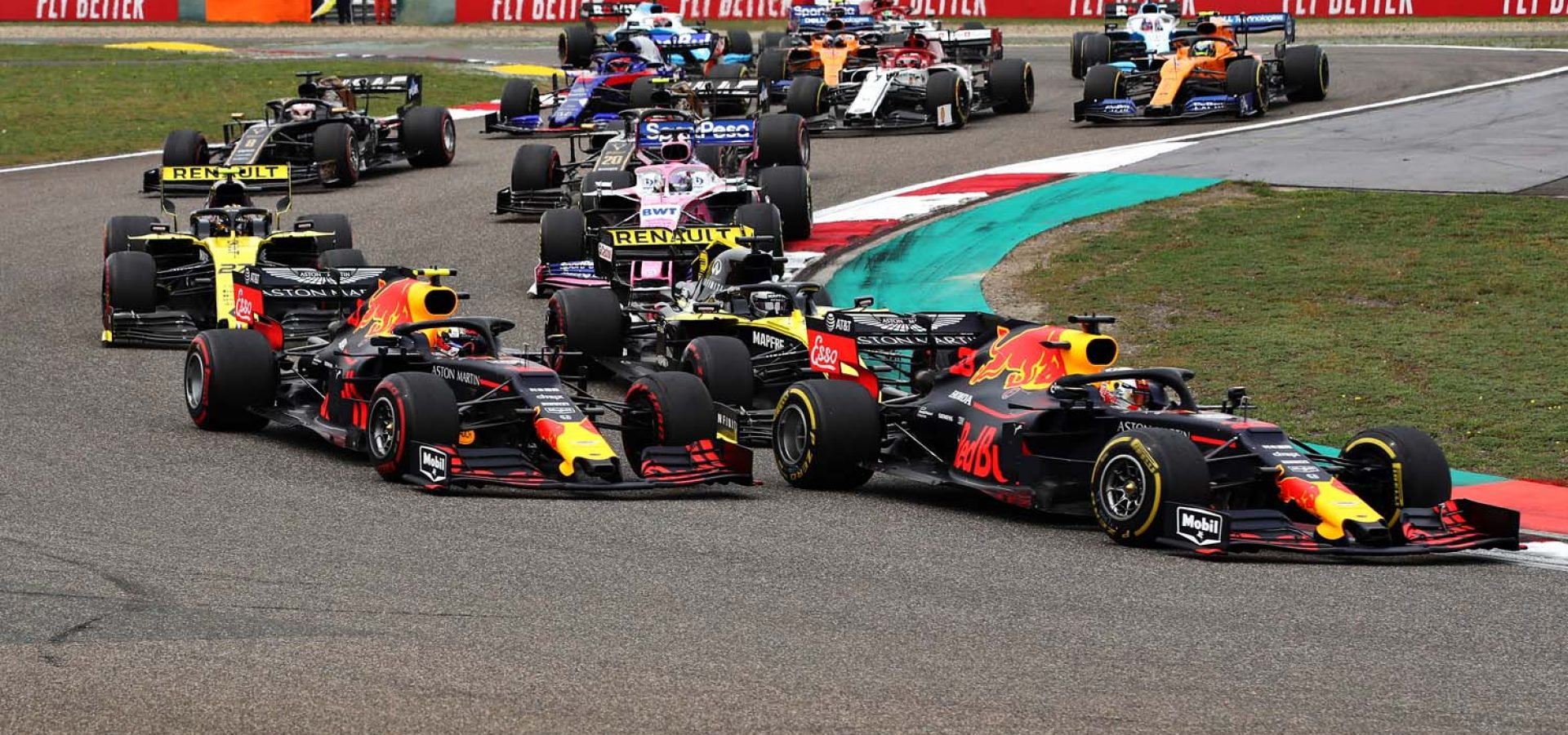 SHANGHAI, CHINA - APRIL 14: Max Verstappen of the Netherlands driving the (33) Aston Martin Red Bull Racing RB15 leads Pierre Gasly of France driving the (10) Aston Martin Red Bull Racing RB15 at the start during the F1 Grand Prix of China at Shanghai International Circuit on April 14, 2019 in Shanghai, China. (Photo by Mark Thompson/Getty Images) // Getty Images / Red Bull Content Pool  // AP-1Z1CYAMNH1W11 // Usage for editorial use only // Please go to www.redbullcontentpool.com for further information. //