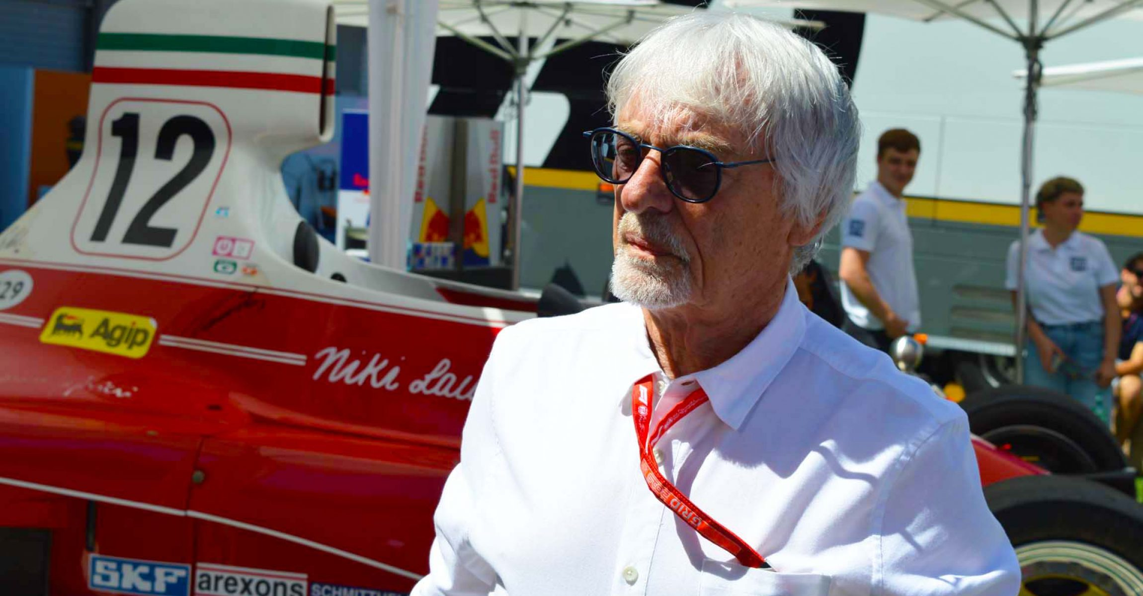 Bernie Ecclestone with Niki Lauda's car in the background, Red Bull Ring, Spielberg, Austria, 28.07.2019