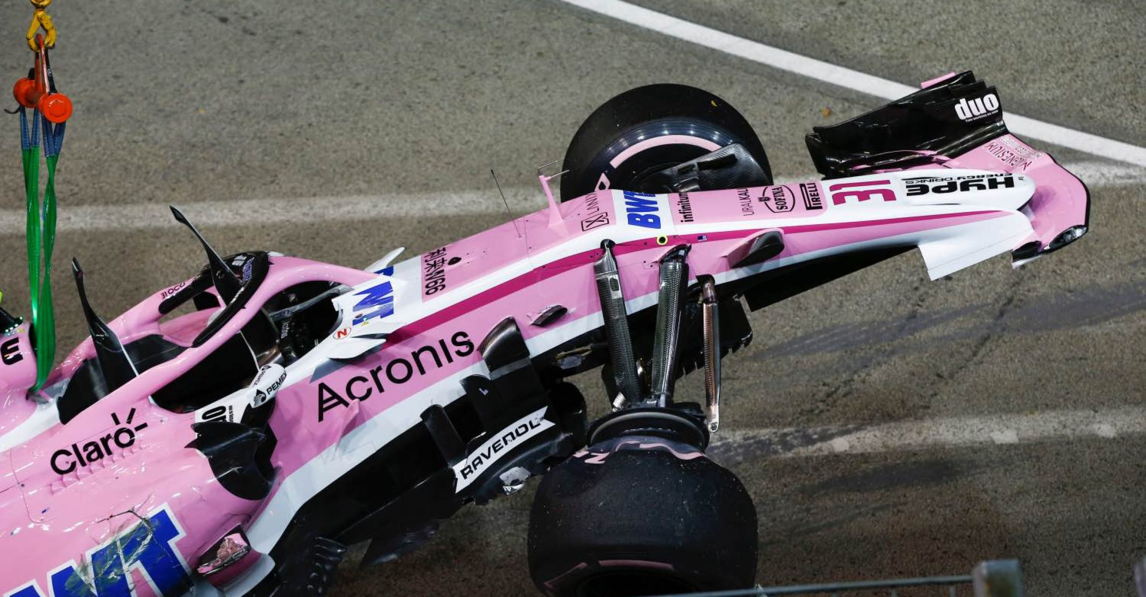 The crashed car of Esteban Ocon, Racing Point Force India VJM11 is recovered at Formula One World Championship, Rd15, Singapore Grand Prix, Race, Marina Bay Circuit, Singapore, Sunday 16 September 2018.