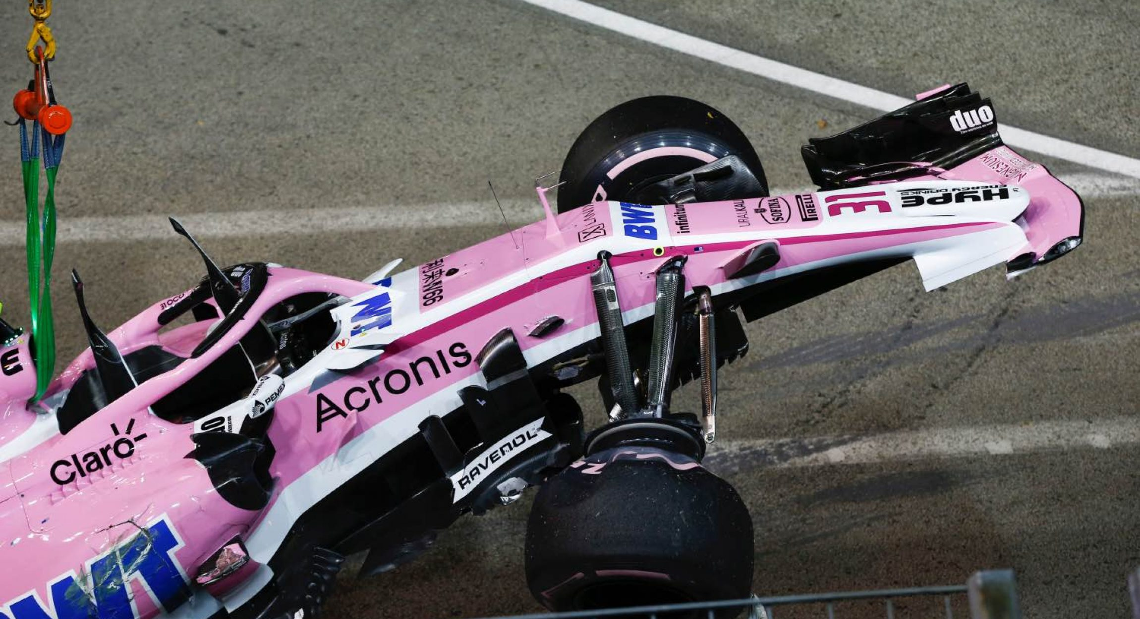 The crashed car of Esteban Ocon, Racing Point Force India VJM11 is recovered at Formula One World Championship, Rd15, Singapore Grand Prix, Race, Marina Bay Circuit, Singapore, Sunday 16 September 2018.