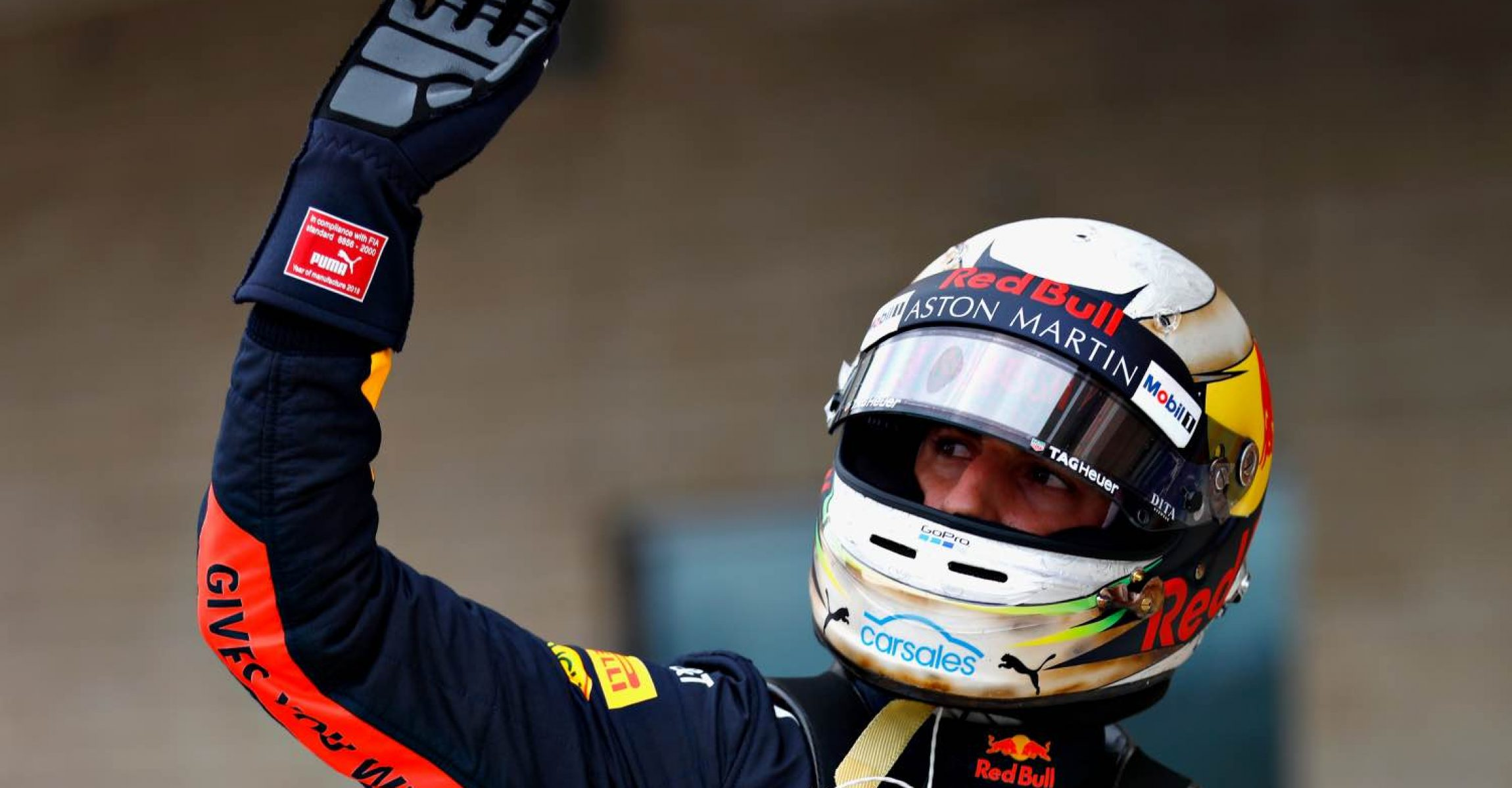 AUSTIN, TX - OCTOBER 20: Daniel Ricciardo of Australia and Red Bull Racing waves to the crowd from parc ferme during qualifying for the United States Formula One Grand Prix at Circuit of The Americas on October 20, 2018 in Austin, United States.  (Photo by Will Taylor-Medhurst/Getty Images)