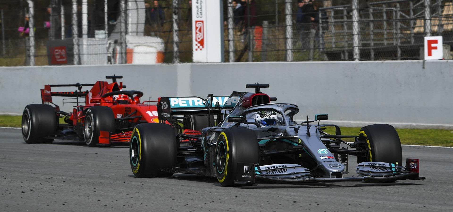 CIRCUIT DE BARCELONA-CATALUNYA, SPAIN - FEBRUARY 28: Valtteri Bottas, Mercedes F1 W11 EQ Performance, leads Charles Leclerc, Ferrari SF1000 during the Barcelona February testing II at Circuit de Barcelona-Catalunya on February 28, 2020 in Circuit de Barcelona-Catalunya, Spain. (Photo by Mark Sutton / LAT Images)