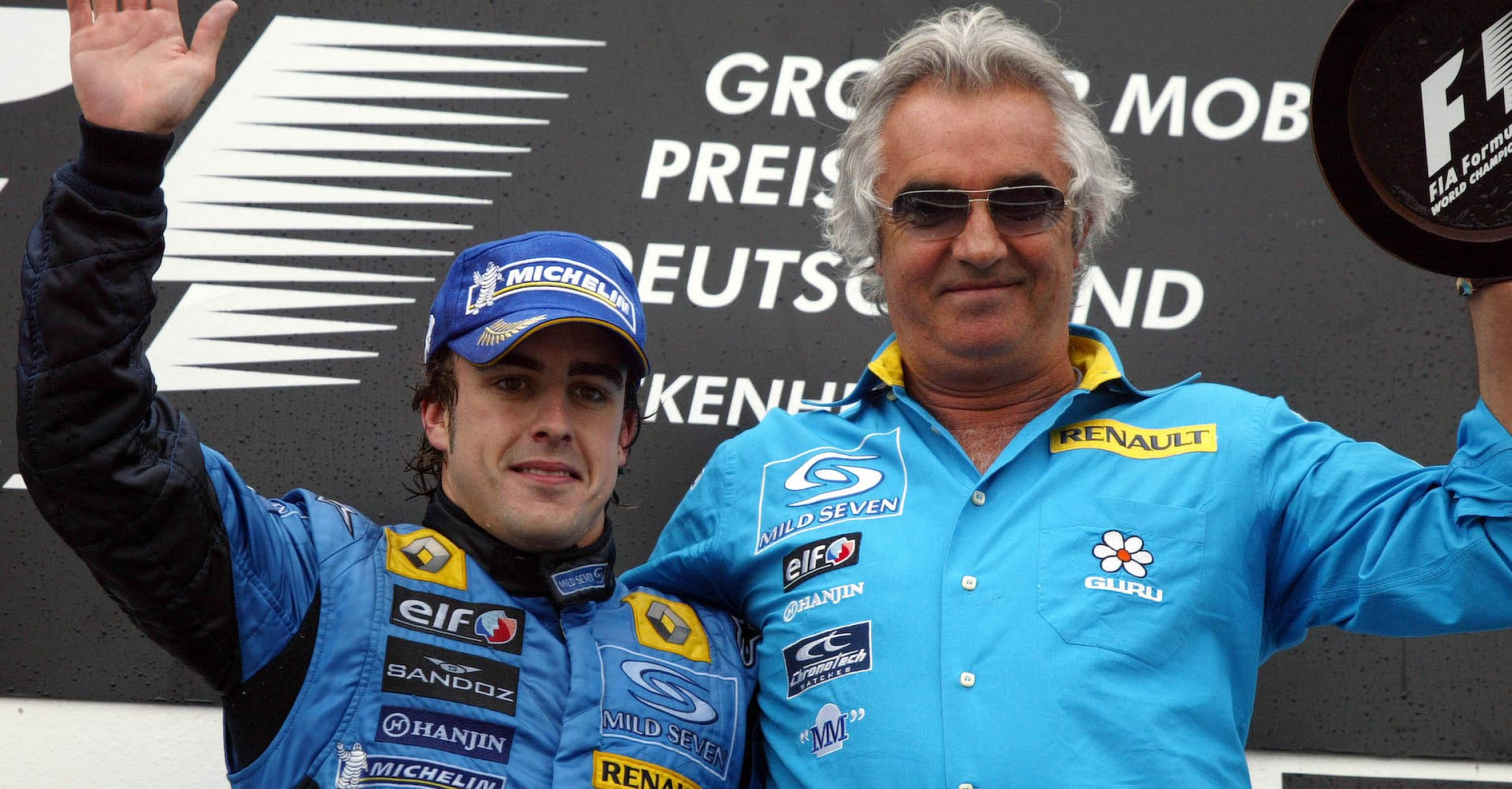 24.07.2005 Hockenheim, Germany, Fernando Alonso, ESP, Renault F1 Team and Flavio Briatore, ITA, Renault, Teamchief, Managing Director - July, Formula 1 World Championship, Rd 12, German Grand Prix, Hockenheim, Germany, Grosser Mobil 1 Preis von Deutschland, GER, Hockenheimring Baden-W¸rttemberg, Podium - www.xpb.cc, EMail: info@xpb.cc - copy of publication required for printed pictures.