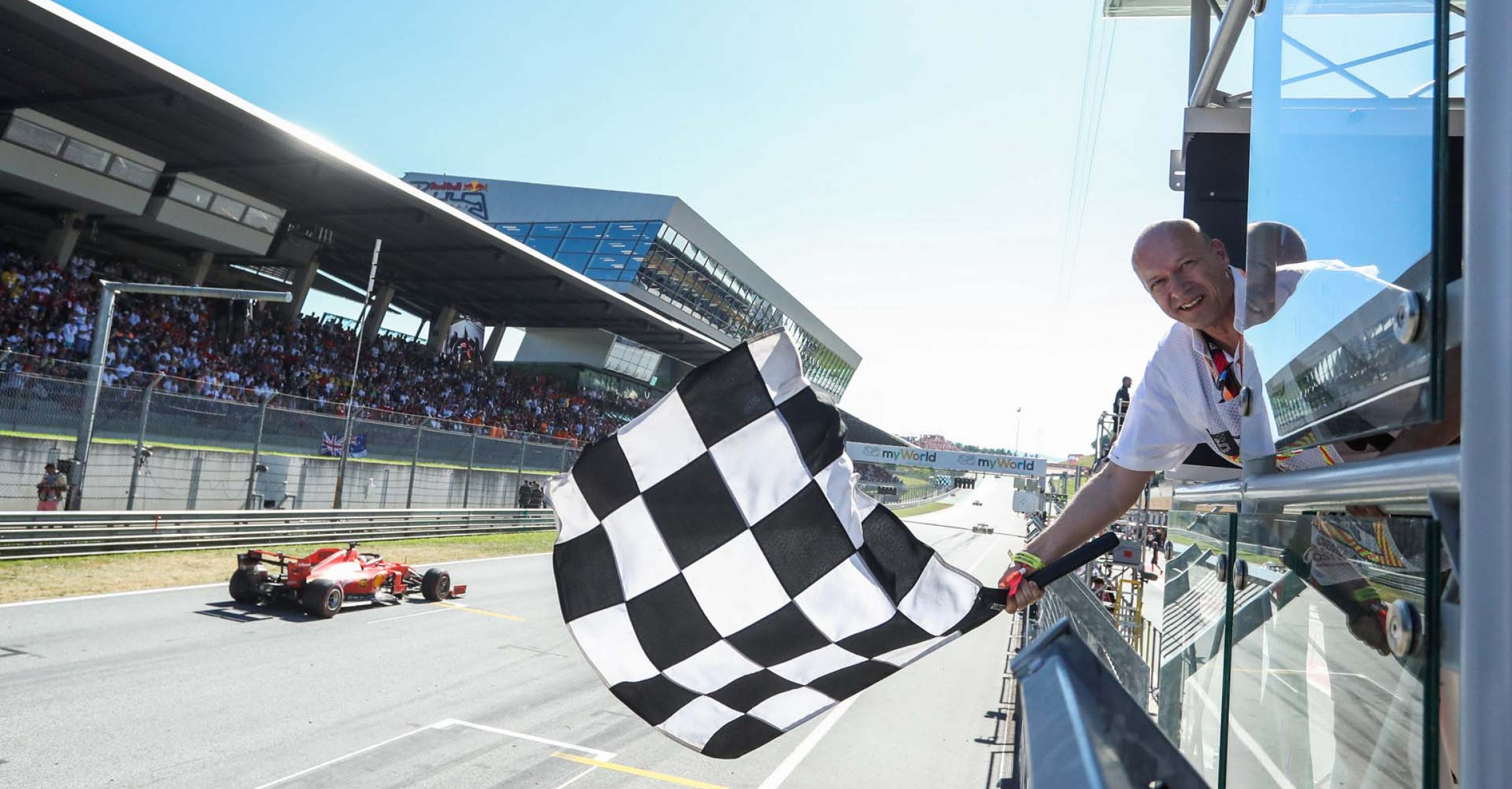 SPIELBERG,AUSTRIA,30.JUN.19 - MOTORSPORTS, FORMULA 1 - Grand Prix of Austria, Red Bull Ring. Image shows Sebastian Vettel (GER/ Ferrari) and the superfan. Photo: GEPA pictures/ Daniel Goetzhaber - For editorial use only. Image is free of charge.