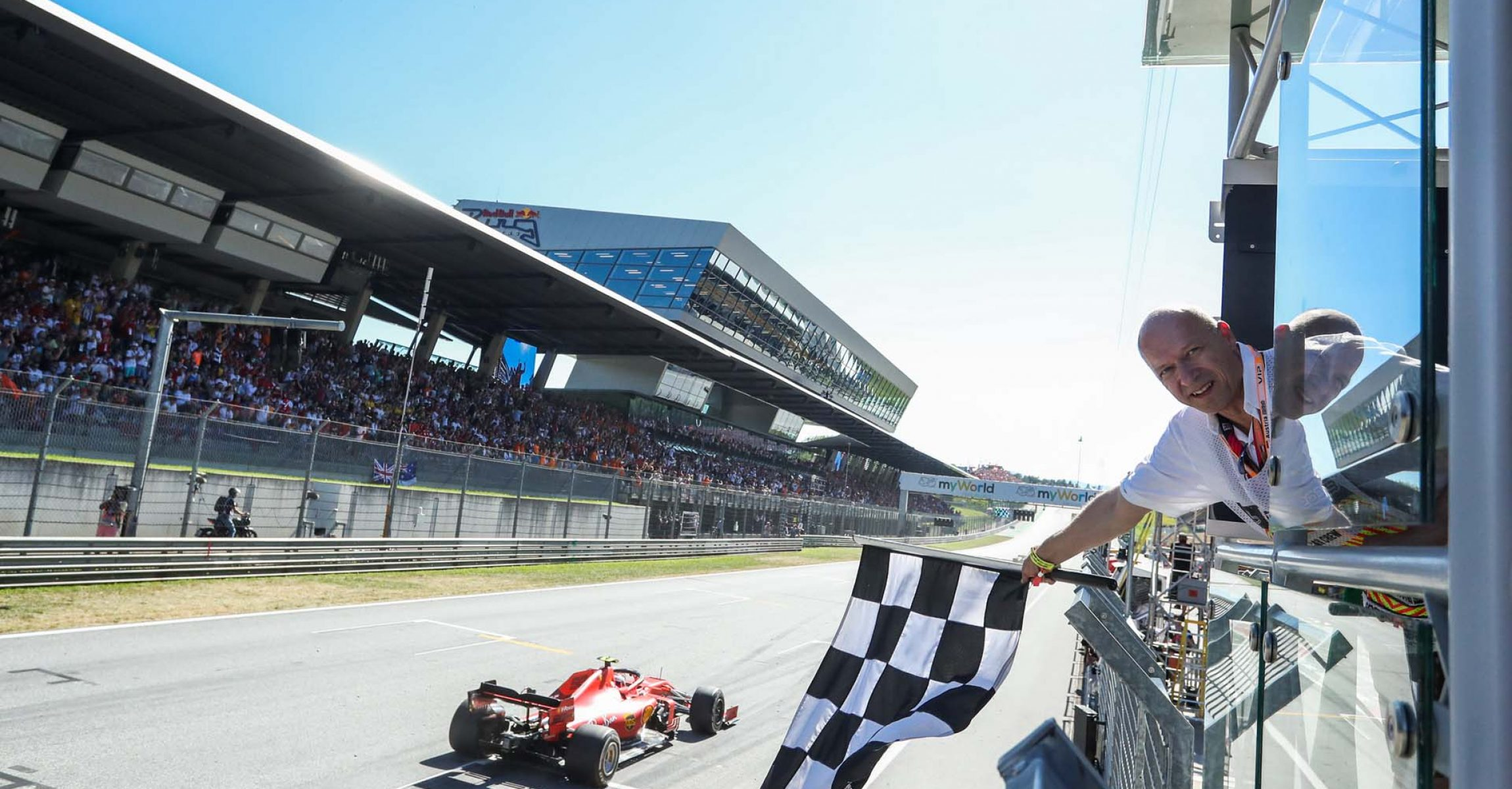 SPIELBERG,AUSTRIA,30.JUN.19 - MOTORSPORTS, FORMULA 1 - Grand Prix of Austria, Red Bull Ring. Image shows Charles Leclerc (MON/ Ferrari) and the superfan. Photo: GEPA pictures/ Daniel Goetzhaber - For editorial use only. Image is free of charge.