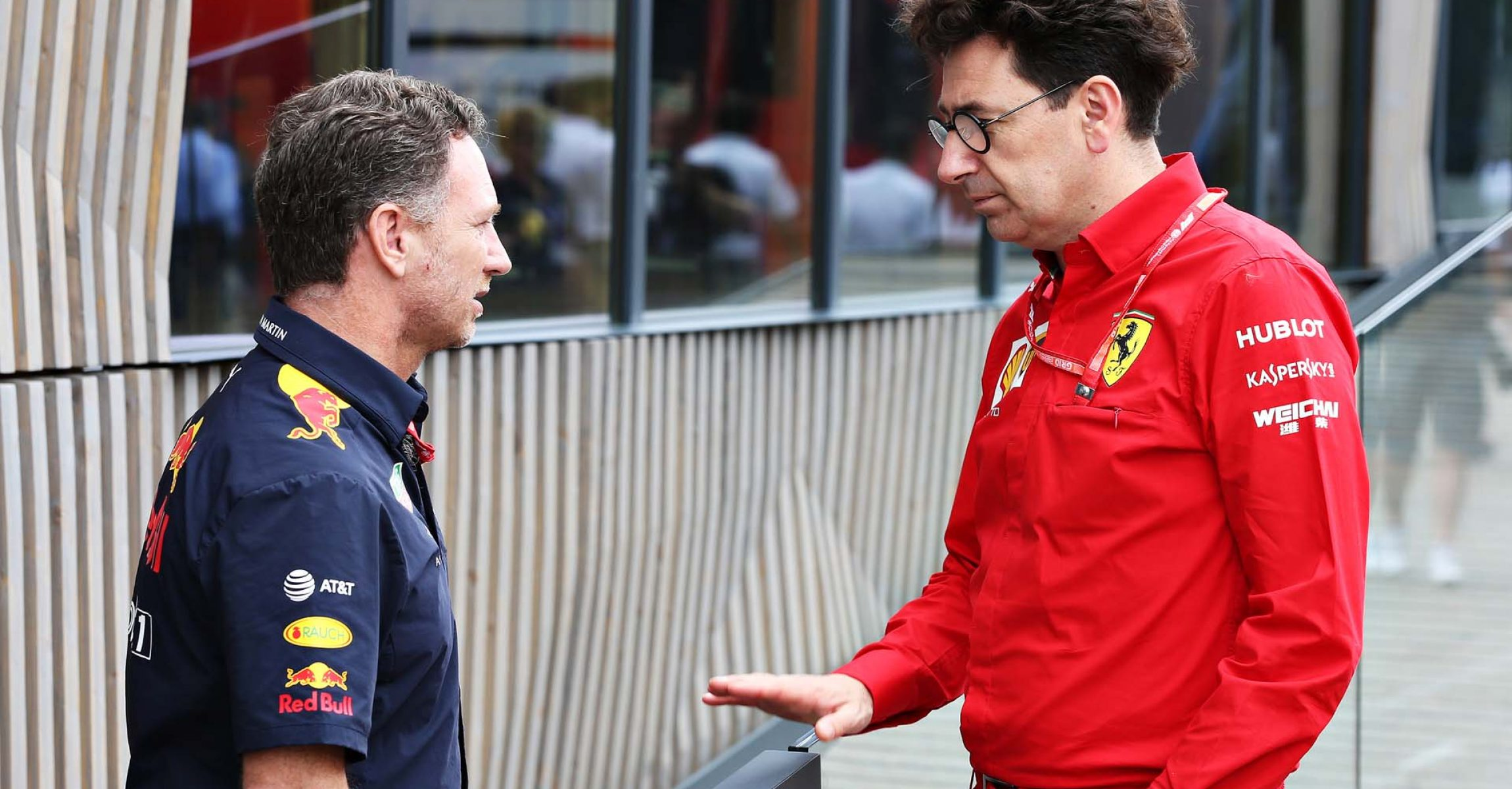 HOCKENHEIM, GERMANY - JULY 27: Red Bull Racing Team Principal Christian Horner and Ferrari Team Principal Mattia Binotto talk in the Paddock before final practice for the F1 Grand Prix of Germany at Hockenheimring on July 27, 2019 in Hockenheim, Germany. (Photo by Charles Coates/Getty Images) // Getty Images / Red Bull Content Pool // AP-212XN7TMN2511 // Usage for editorial use only // Please go to www.redbullcontentpool.com for further information. //