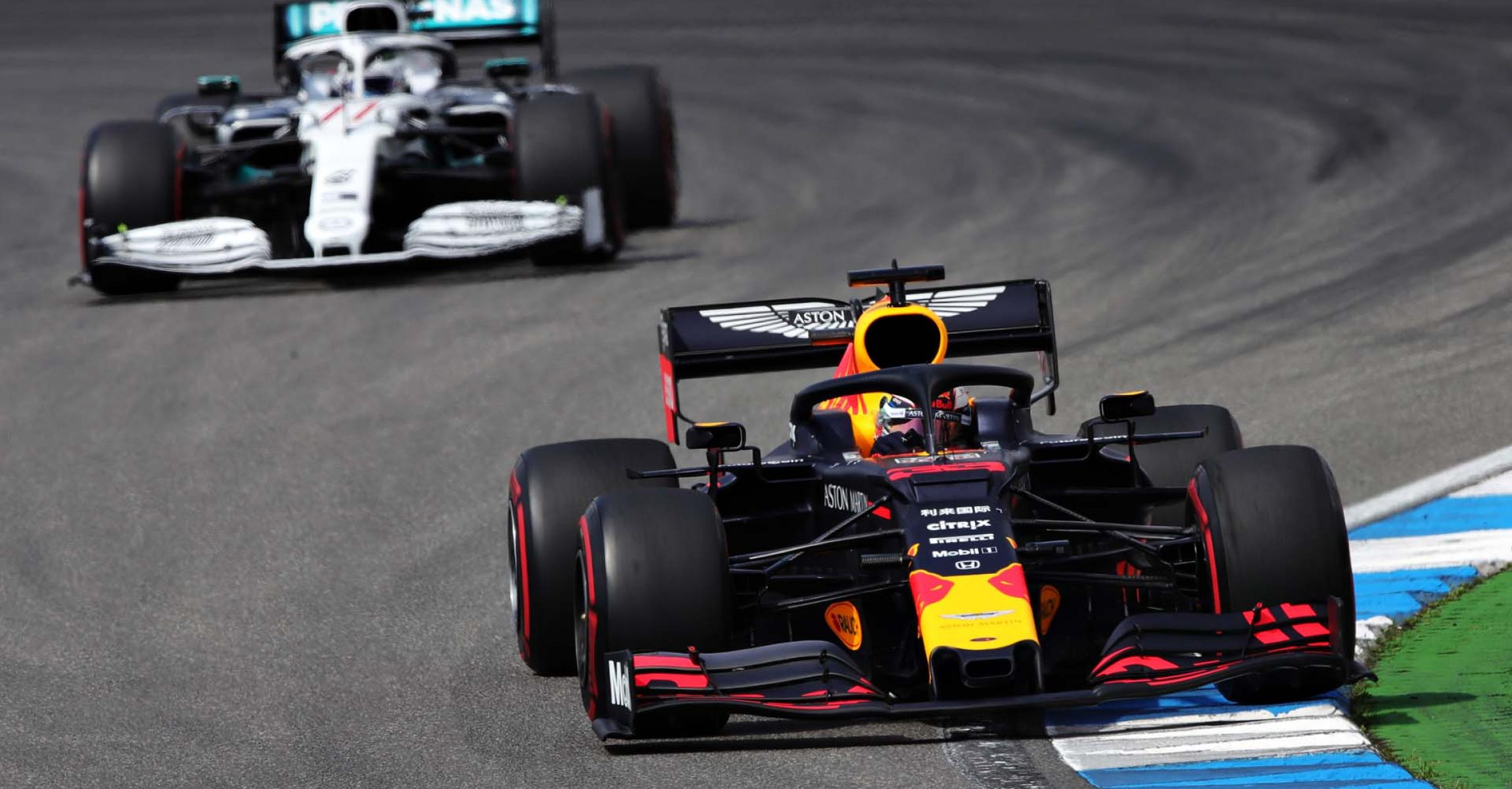HOCKENHEIM, GERMANY - JULY 27: Max Verstappen of the Netherlands driving the (33) Aston Martin Red Bull Racing RB15 leads Valtteri Bottas driving the (77) Mercedes AMG Petronas F1 Team Mercedes W10 on track during qualifying for the F1 Grand Prix of Germany at Hockenheimring on July 27, 2019 in Hockenheim, Germany. (Photo by Alexander Hassenstein/Getty Images) // Getty Images / Red Bull Content Pool  // AP-212Y598S12111 // Usage for editorial use only // Please go to www.redbullcontentpool.com for further information. //