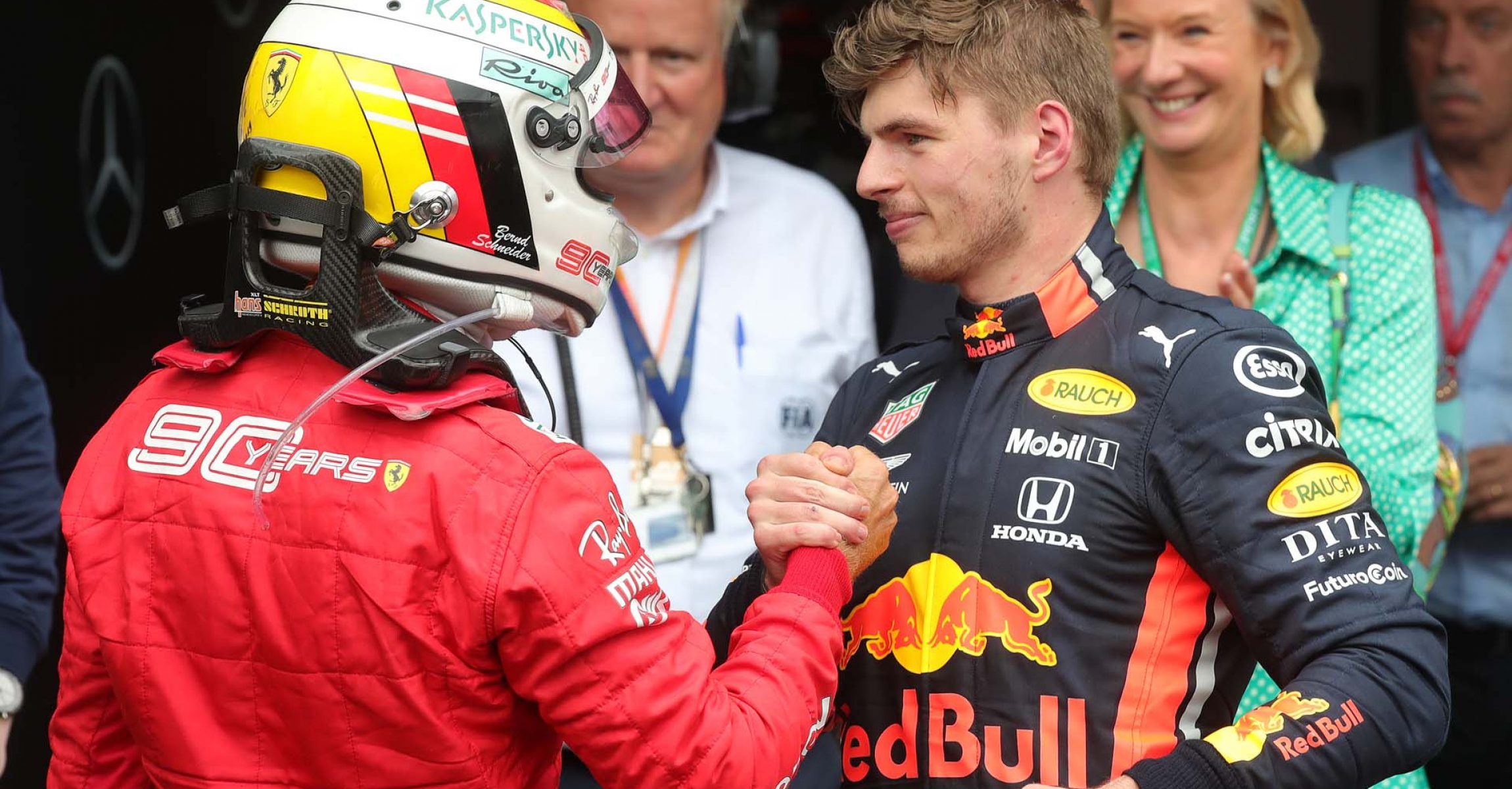 HOCKENHEIM, GERMANY - JULY 28: Race winner Max Verstappen of Netherlands and Red Bull Racing and second placed Sebastian Vettel of Germany and Ferrari celebrate in parc ferme during the F1 Grand Prix of Germany at Hockenheimring on July 28, 2019 in Hockenheim, Germany. (Photo by Alexander Hassenstein/Getty Images) // Getty Images / Red Bull Content Pool  // AP-213AK55FD2111 // Usage for editorial use only // Please go to www.redbullcontentpool.com for further information. //