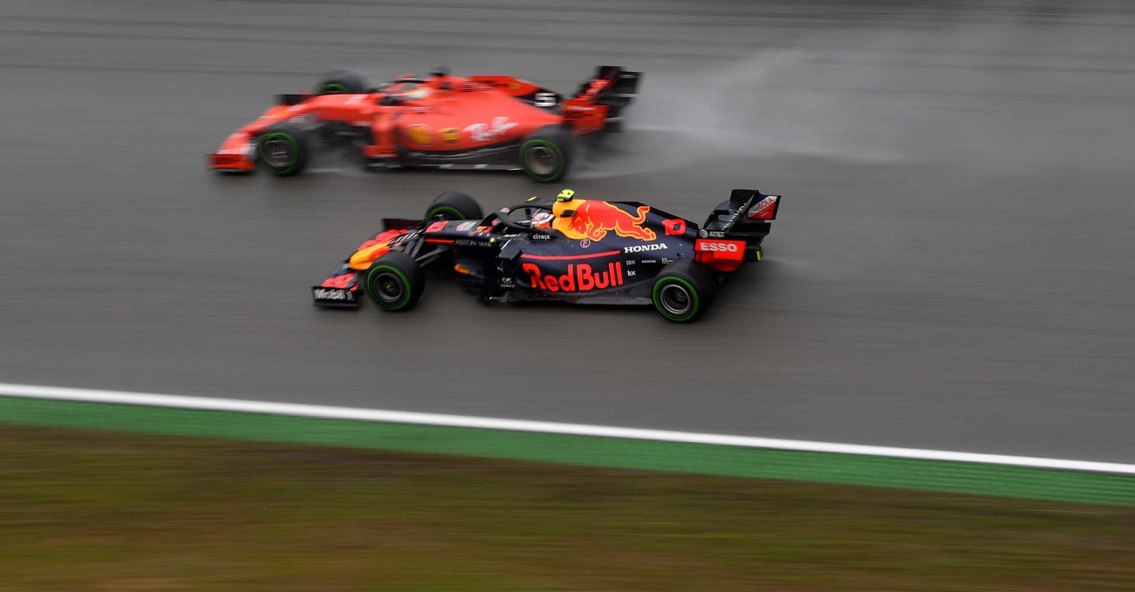 HOCKENHEIM, GERMANY - JULY 28: Pierre Gasly of France driving the (10) Aston Martin Red Bull Racing RB15 and Sebastian Vettel of Germany driving the (5) Scuderia Ferrari SF90 on track during the F1 Grand Prix of Germany at Hockenheimring on July 28, 2019 in Hockenheim, Germany. (Photo by Dan Mullan/Getty Images) // Getty Images / Red Bull Content Pool // AP-213AXX2HS2111 // Usage for editorial use only // Please go to www.redbullcontentpool.com for further information. //