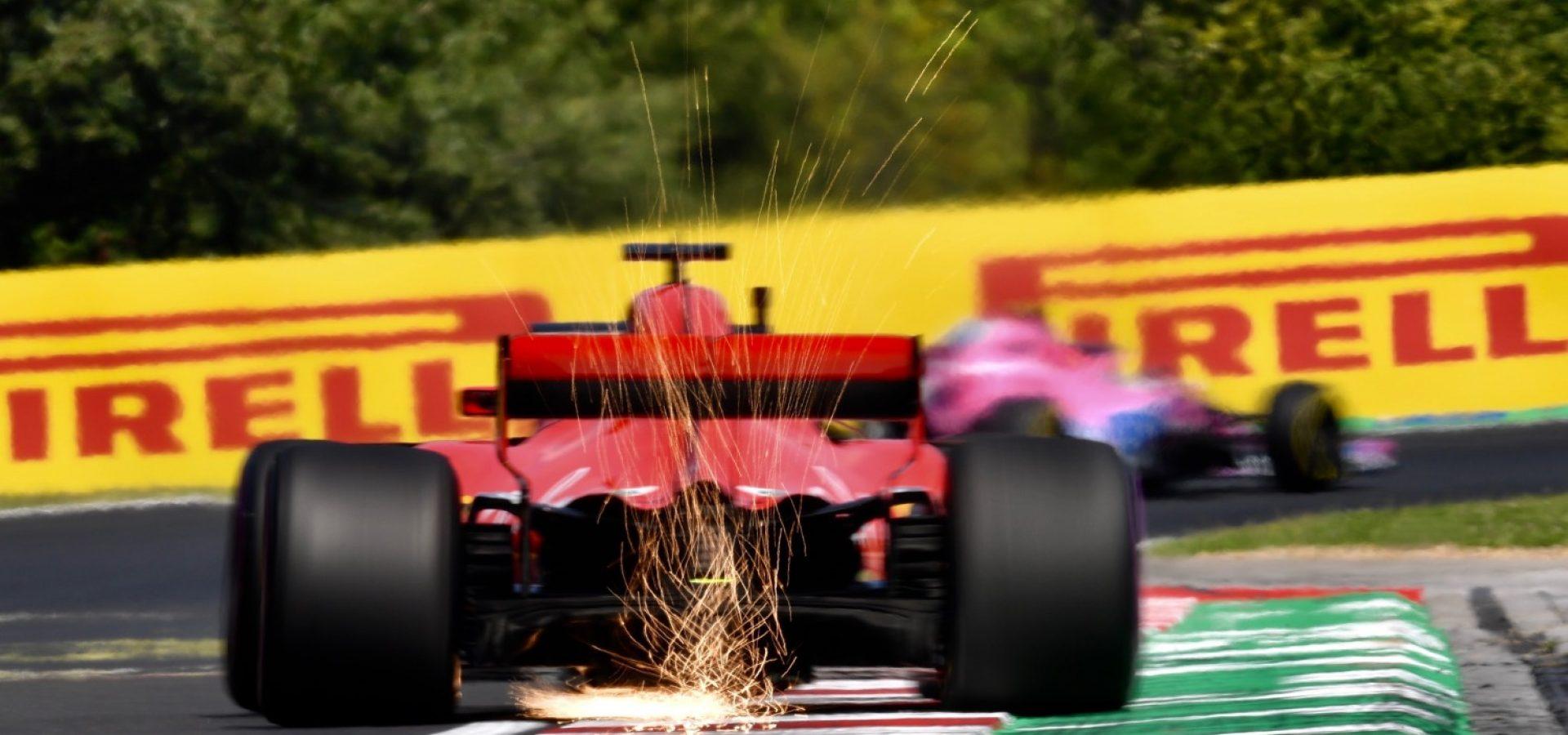 HUNGARORING, HUNGARY - JULY 27: Sebastian Vettel (GER) Ferrari SF-71H sparks during the Hungarian GP at Hungaroring on July 27, 2018 in Hungaroring, Hungary. (Photo by Jerry Andre / Sutton Images)
