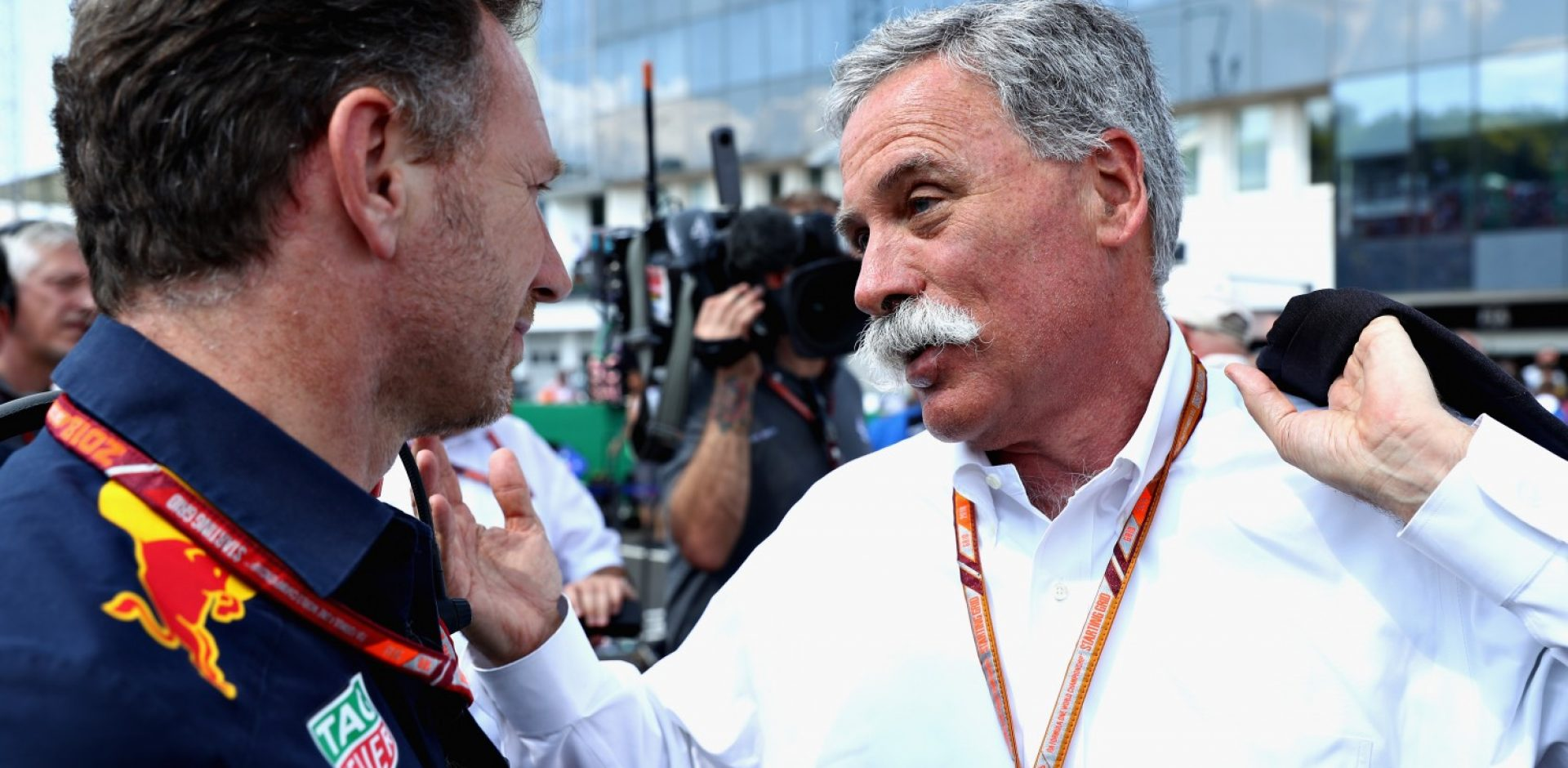 BUDAPEST, HUNGARY - JULY 29: Red Bull Racing Team Principal Christian Horner talks with Chase Carey, CEO and Executive Chairman of the Formula One Group, on the grid before the Formula One Grand Prix of Hungary at Hungaroring on July 29, 2018 in Budapest, Hungary.  (Photo by Mark Thompson/Getty Images)