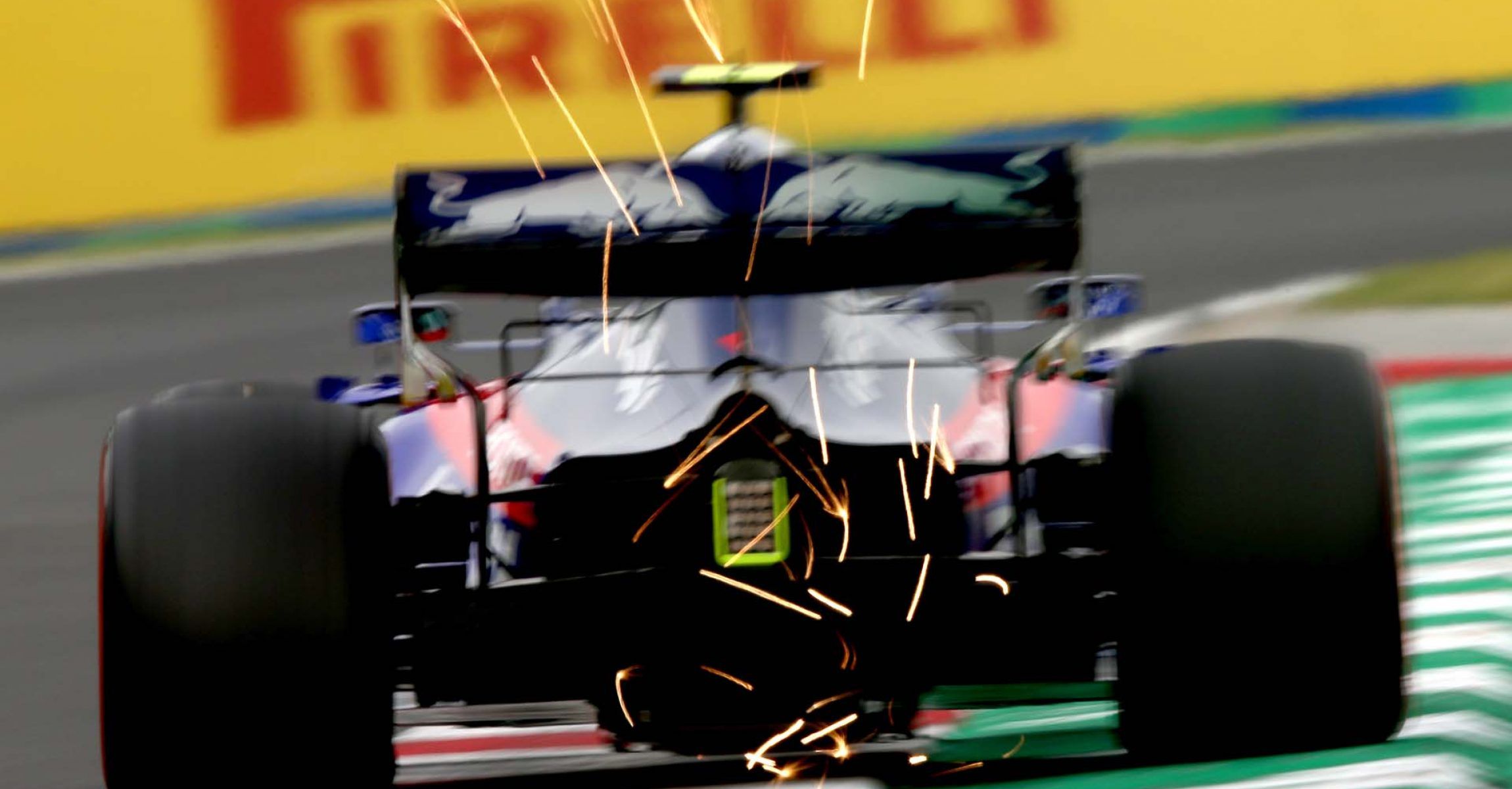 BUDAPEST, HUNGARY - AUGUST 02: Sparks fly behind Alexander Albon of Thailand driving the (23) Scuderia Toro Rosso STR14 Honda on track during practice for the F1 Grand Prix of Hungary at Hungaroring on August 02, 2019 in Budapest, Hungary. (Photo by Charles Coates/Getty Images) // Getty Images / Red Bull Content Pool  // AP-214VKTATS1W11 // Usage for editorial use only // Please go to www.redbullcontentpool.com for further information. //