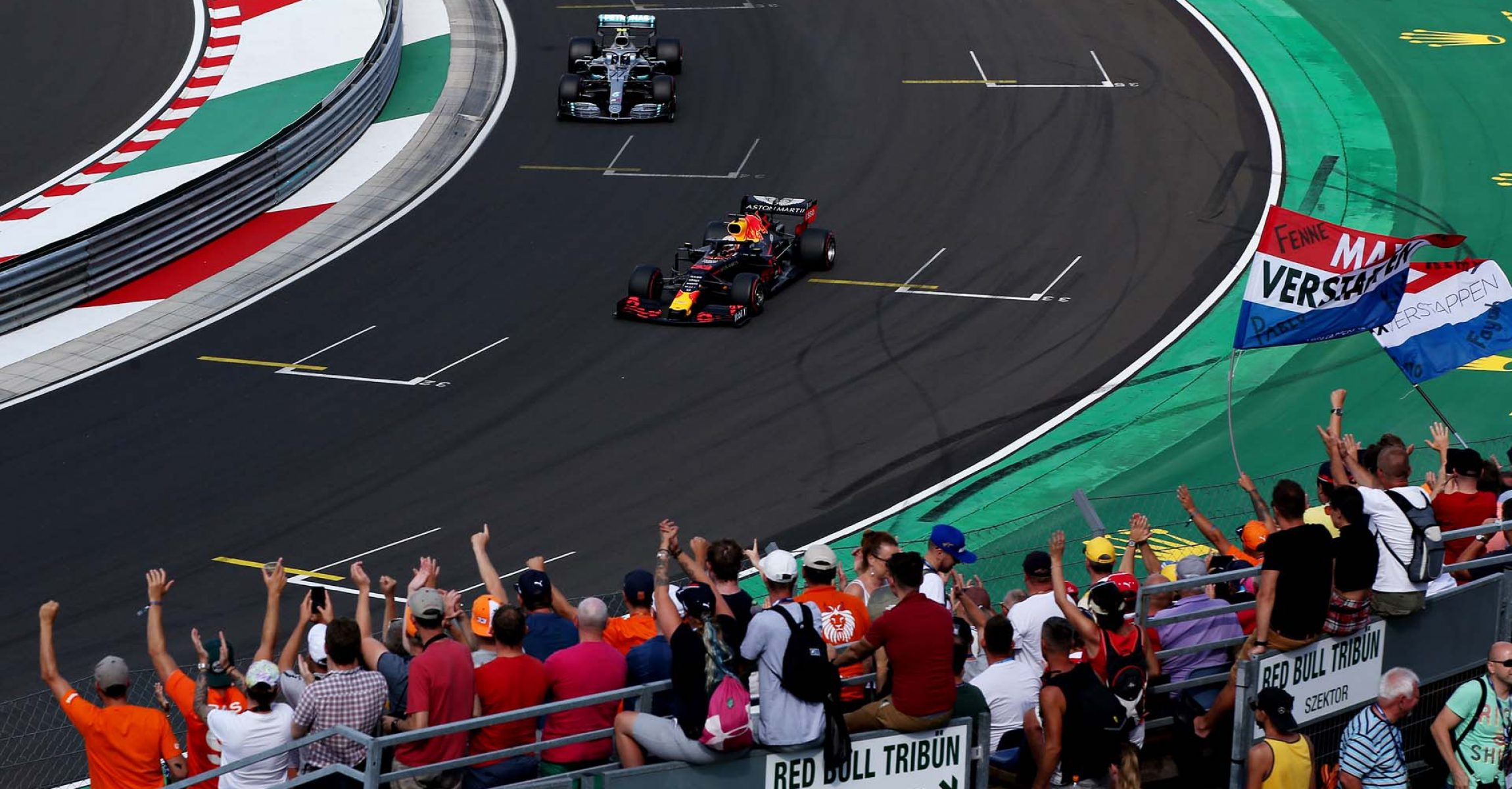 BUDAPEST, HUNGARY - AUGUST 03: Fans celebrate as pole position qualifier Max Verstappen of the Netherlands driving the (33) Aston Martin Red Bull Racing RB15 pulls into parc ferme ahead of second placed qualifier Valtteri Bottas of Finland and Mercedes GP during qualifying for the F1 Grand Prix of Hungary at Hungaroring on August 03, 2019 in Budapest, Hungary. (Photo by Charles Coates/Getty Images) // Getty Images / Red Bull Content Pool // AP-2157QXQQD1W11 // Usage for editorial use only // Please go to www.redbullcontentpool.com for further information. //