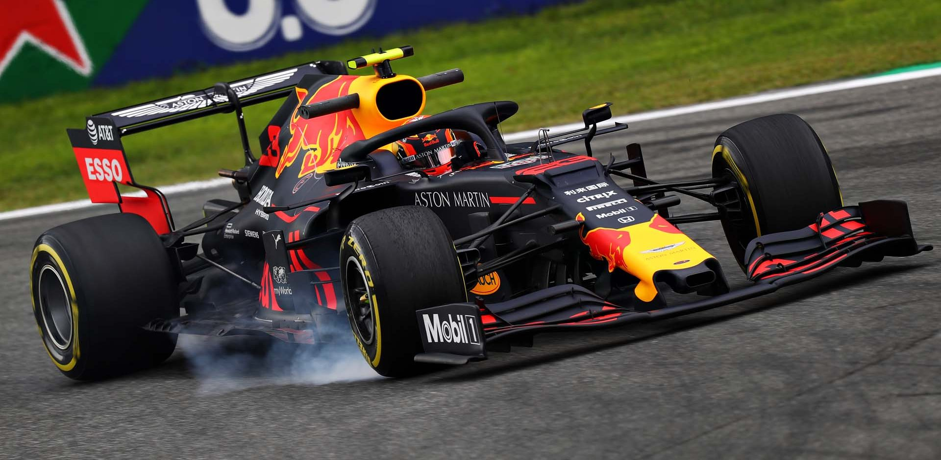 MONZA, ITALY - SEPTEMBER 06: Alexander Albon of Thailand driving the (23) Aston Martin Red Bull Racing RB15 locks a wheel under braking during practice for the F1 Grand Prix of Italy at Autodromo di Monza on September 06, 2019 in Monza, Italy. (Photo by Lars Baron/Getty Images) // Getty Images / Red Bull Content Pool  // AP-21G5FBSZ52111 // Usage for editorial use only //