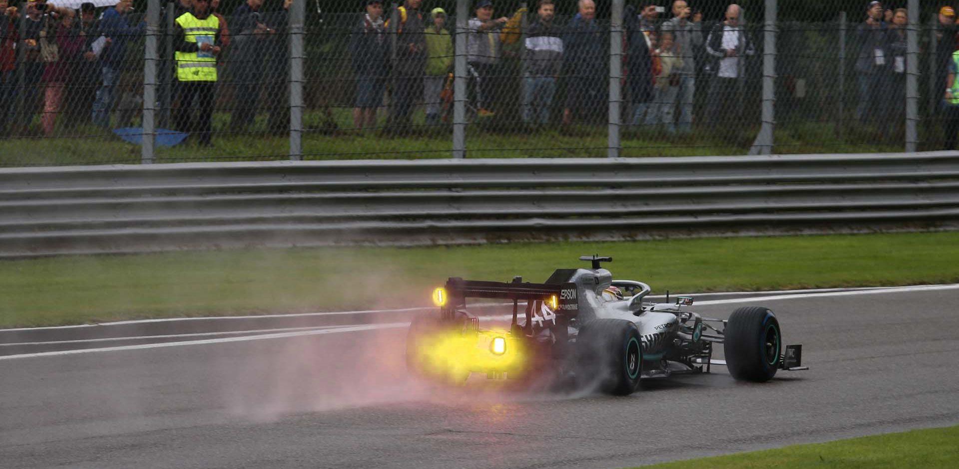 Lewis Hamilton Mercedes yellow rain light