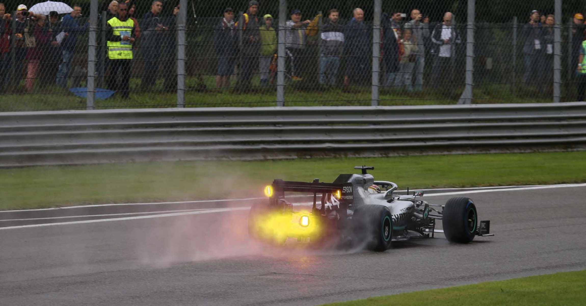 Lewis Hamilton Mercedes yellow rain light