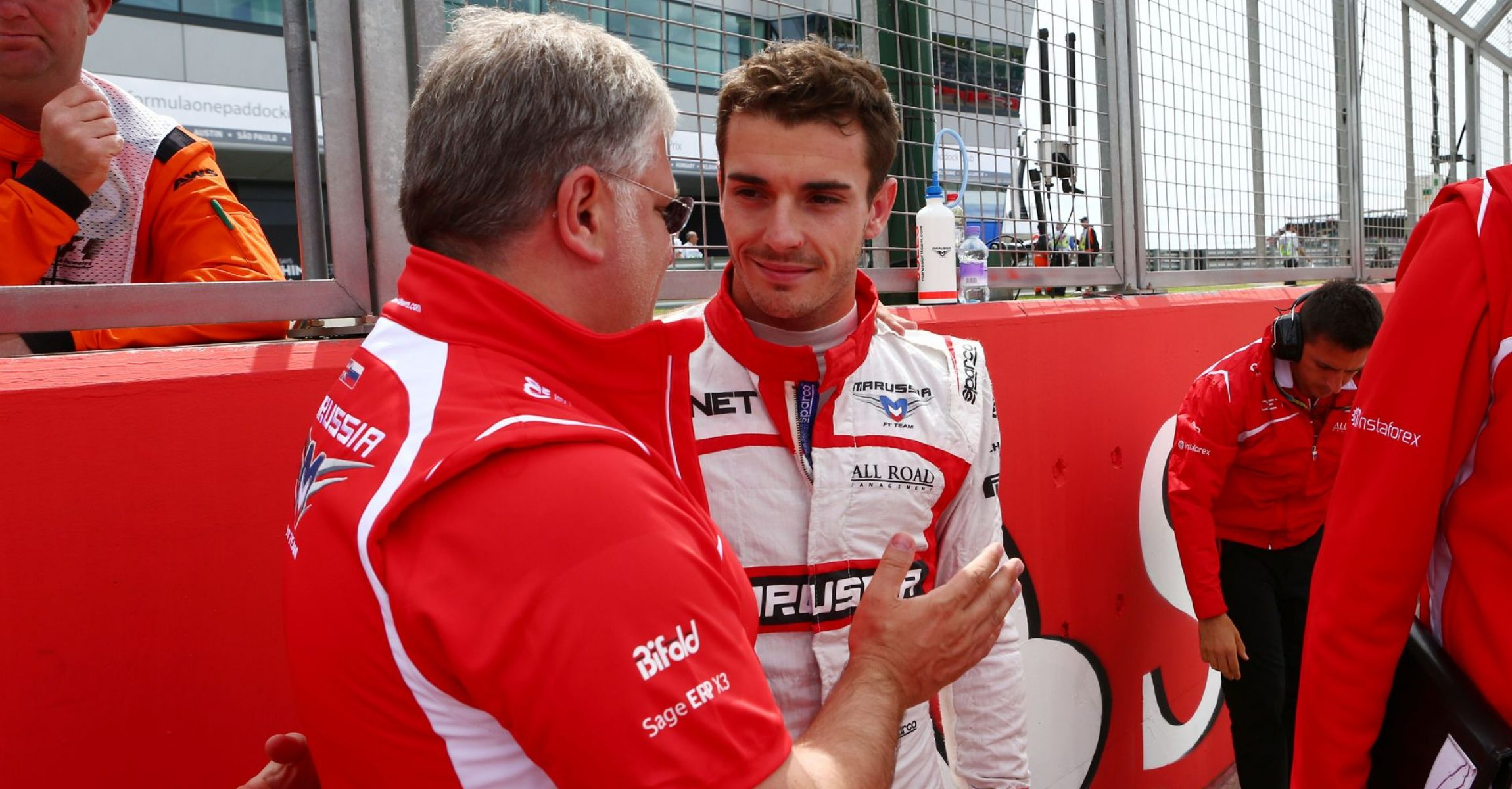 (L to R): Andrei Cheglakov (RUS) Marussia Team Owner on the grid with Jules Bianchi (FRA) Marussia F1 Team. 06.07.2014. Formula 1 World Championship, Rd 9, British Grand Prix, Silverstone, England, Race Day.