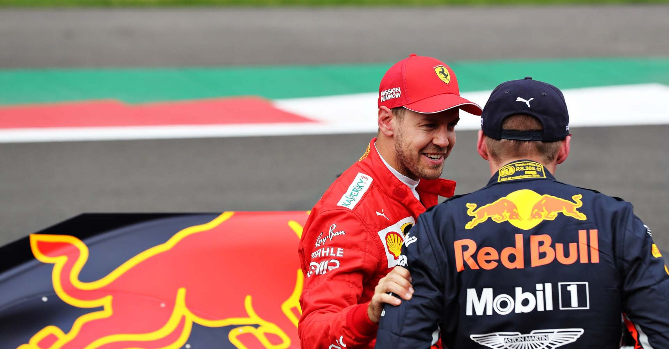 MEXICO CITY, MEXICO - OCTOBER 26: Pole position qualifier Max Verstappen of Netherlands and Red Bull Racing talks with third place qualifier Sebastian Vettel of Germany and Ferrari in parc ferme during qualifying for the F1 Grand Prix of Mexico at Autodromo Hermanos Rodriguez on October 26, 2019 in Mexico City, Mexico. (Photo by Mark Thompson/Getty Images) // Getty Images / Red Bull Content Pool // AP-21ZBEJ7DW2111 // Usage for editorial use only //