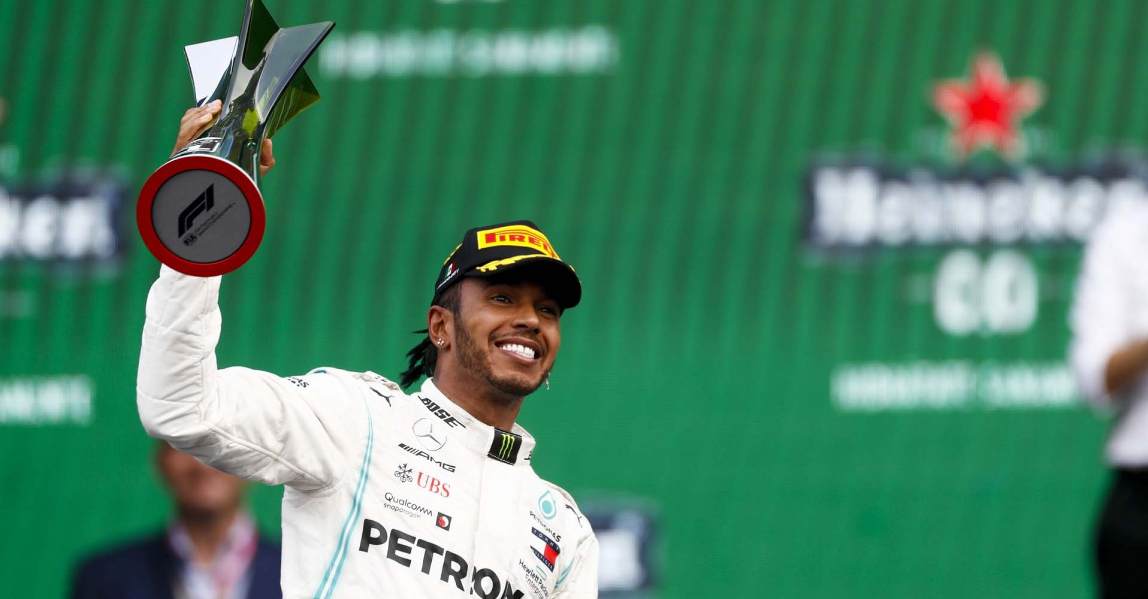 MEXICO CITY - OCTOBER 27: Race winner Lewis Hamilton, Mercedes AMG F1 on the podium with the trophy during the 2019 Formula One Mexican Grand Prix at Autodromo Hermanos Rodriguez, on October 27, 2019 in Mexico City, Mexico. (Photo by Glenn Dunbar / LAT Images)