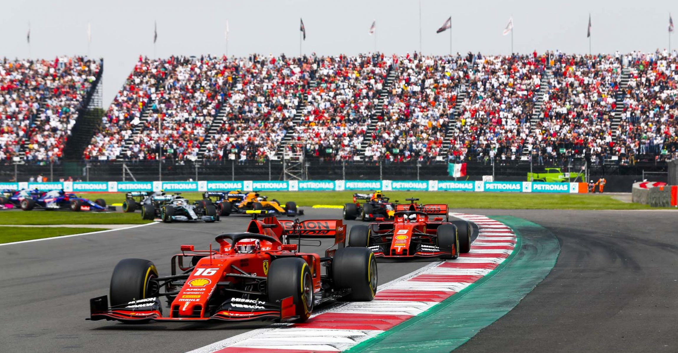 MEXICO CITY - OCTOBER 27: Charles Leclerc, Ferrari SF90 leading Sebastian Vettel, Ferrari SF90 at the start of the race during the 2019 Formula One Mexican Grand Prix at Autodromo Hermanos Rodriguez, on October 27, 2019 in Mexico City, Mexico. (Photo by Joe Portlock / LAT Images)