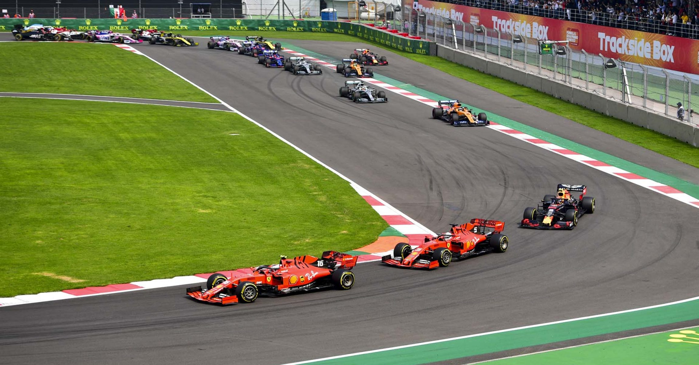 MEXICO CITY - OCTOBER 27: Charles Leclerc, Ferrari SF90 leads Sebastian Vettel, Ferrari SF90 and Alexander Albon, Red Bull RB15 at the start of the race during the 2019 Formula One Mexican Grand Prix at Autodromo Hermanos Rodriguez, on October 27, 2019 in Mexico City, Mexico. (Photo by Simon Galloway / LAT Images)