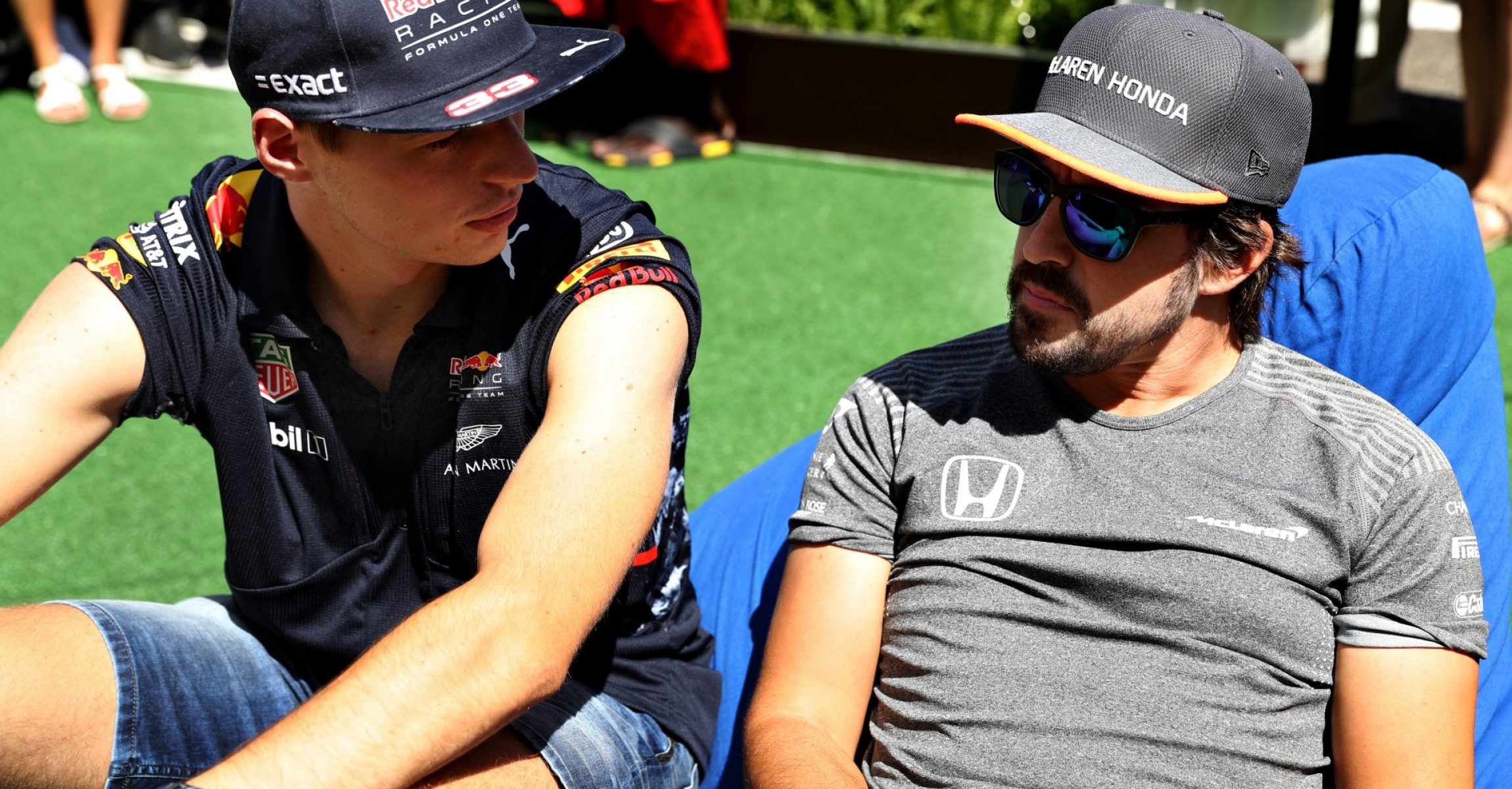 BUDAPEST, HUNGARY - JULY 30: Max Verstappen of Netherlands and Red Bull Racing and Fernando Alonso of Spain and McLaren Honda talk in the Paddock before the Formula One Grand Prix of Hungary at Hungaroring on July 30, 2017 in Budapest, Hungary. (Photo by Mark Thompson/Getty Images)