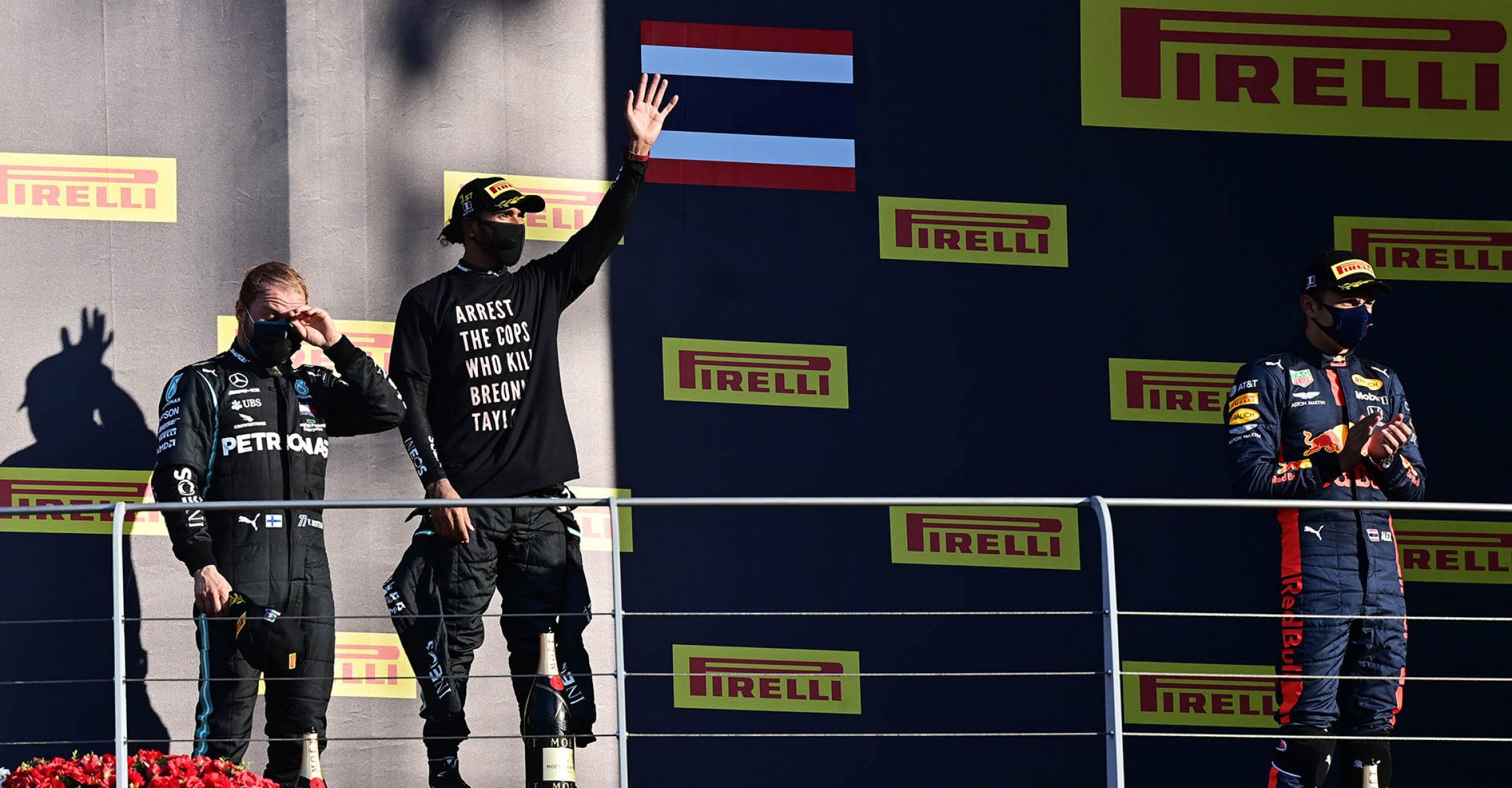 SCARPERIA, ITALY - SEPTEMBER 13: Race winner Lewis Hamilton of Great Britain and Mercedes GP, second placed Valtteri Bottas of Finland and Mercedes GP and third placed Alexander Albon of Thailand and Red Bull Racing celebrate on the podium during the F1 Grand Prix of Tuscany at Mugello Circuit on September 13, 2020 in Scarperia, Italy. (Photo by Miguel Medina - Pool/Getty Images)